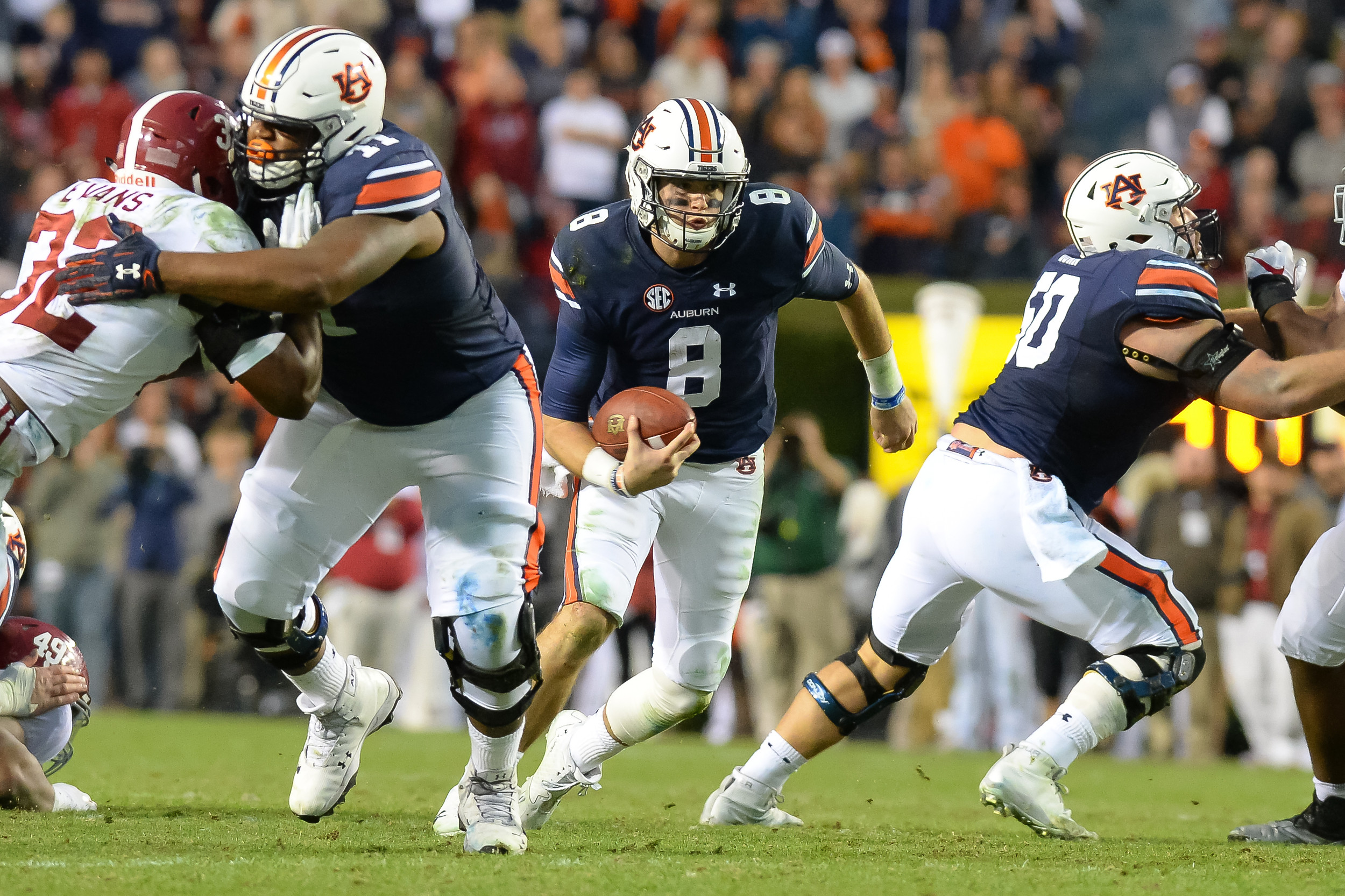 Auburn Tigers quarterback Jarrett Stidham (8) runs for yardage during the second half of Saturday's game, at Jordan-Hare Stadium.