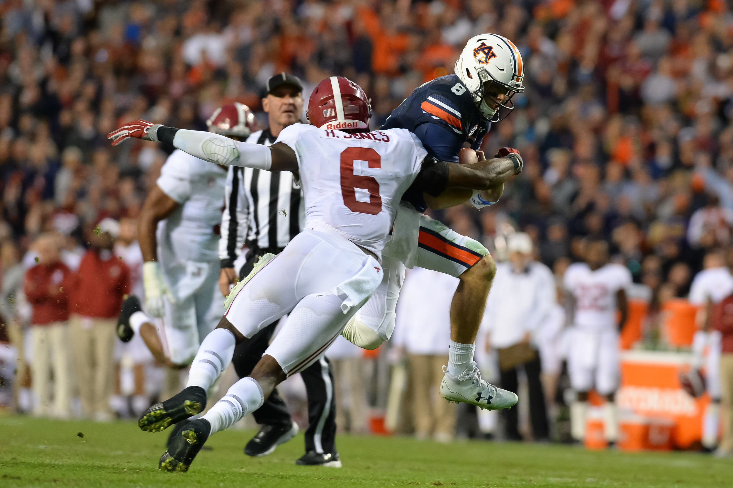 Alabama Crimson Tide defensive back Hootie Jones (6) tackles Auburn Tigers quarterback Jarrett Stidham (8) during the second half of Saturday's game, at Jordan-Hare Stadium.
