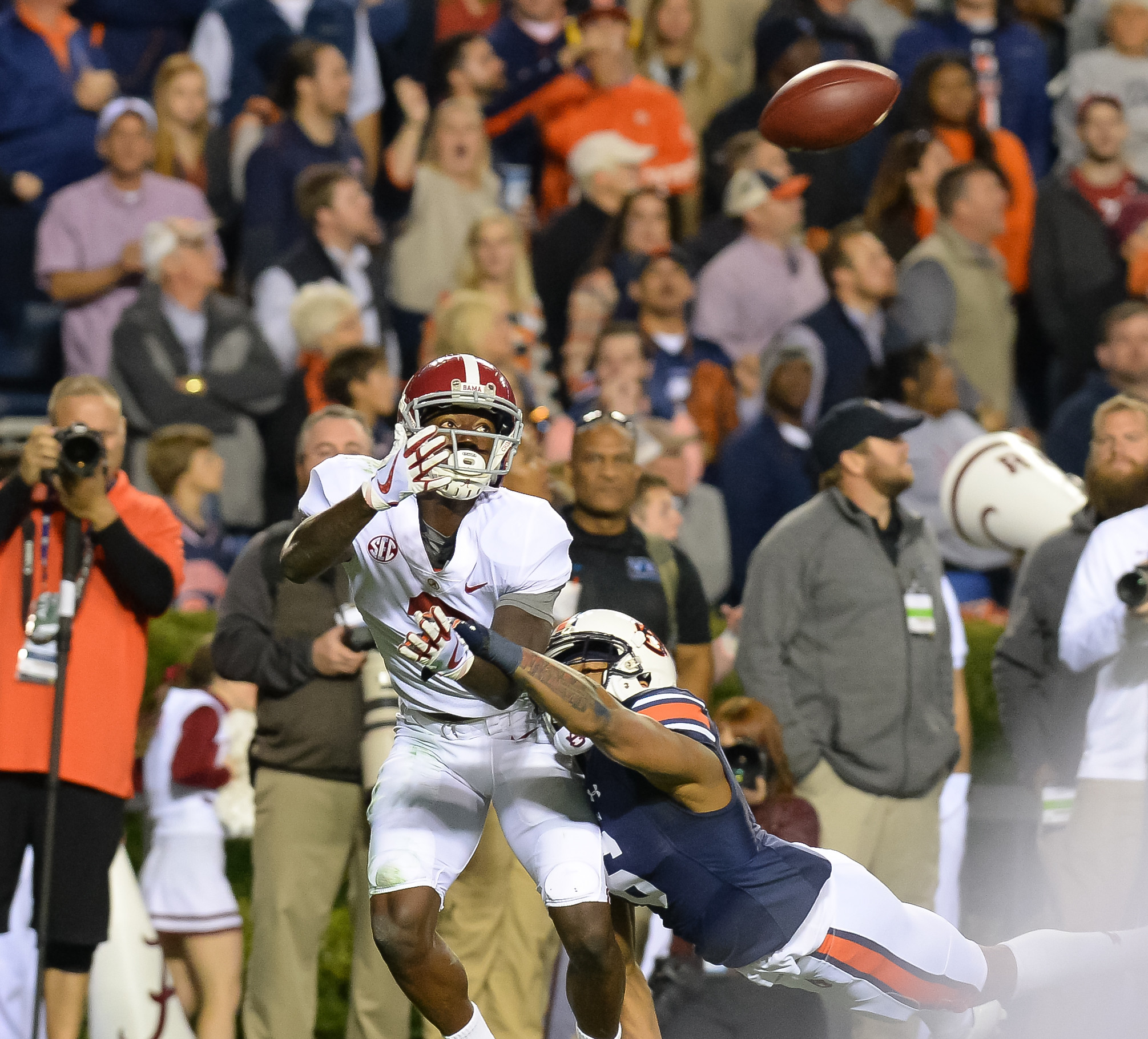 Auburn Tigers defensive back Carlton Davis (6) interferes with Alabama Crimson Tide wide receiver Calvin Ridley (3) during the second half of Saturday's game, at Jordan-Hare Stadium.