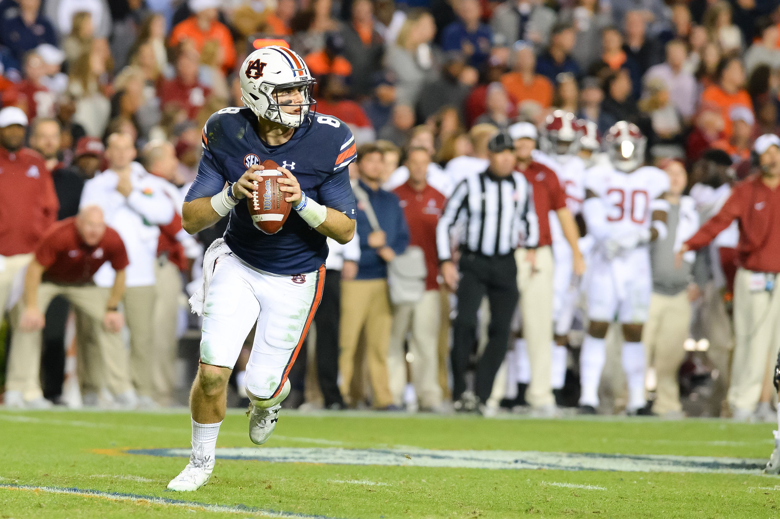 Auburn Tigers quarterback Jarrett Stidham (8) rolls out to pass during the second half of Saturday's game, at Jordan-Hare Stadium.