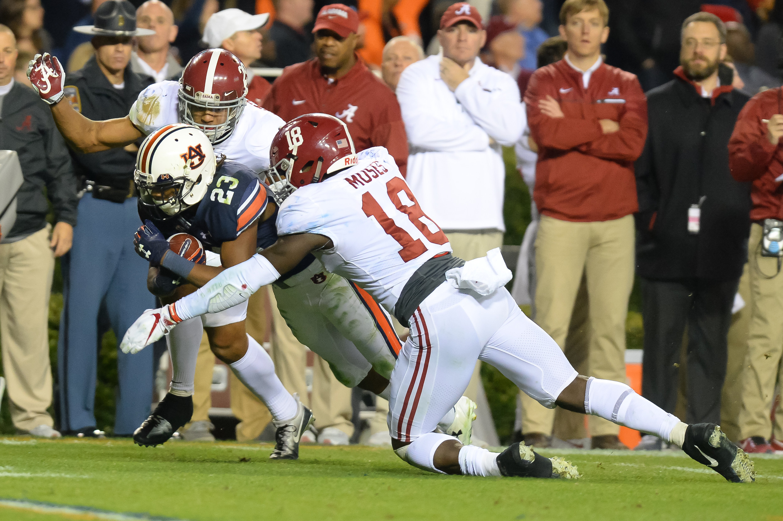 Auburn Tigers wide receiver Ryan Davis (23) is tackled by Alabama Crimson Tide linebacker Dylan Moses and defensive back Minkah Fitzpatrick (29) during the second half of Saturday's game, at Jordan-Hare Stadium.