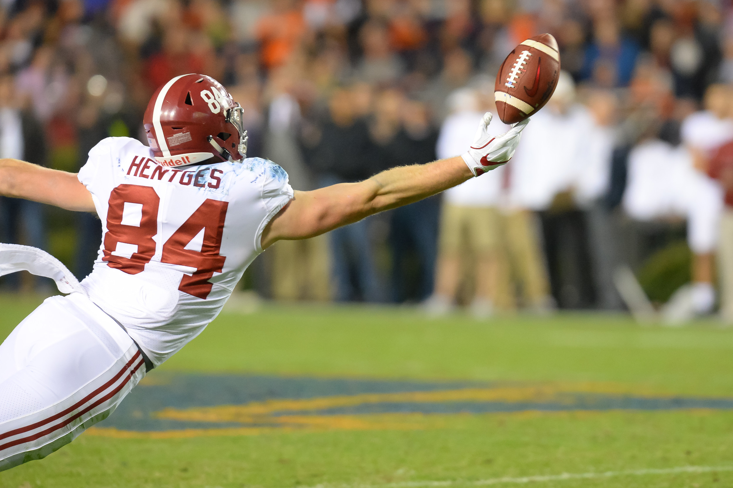 Alabama Crimson Tide tight end Hale Hentges (84) reaches for a ball during the second half of Saturday's game, at Jordan-Hare Stadium.