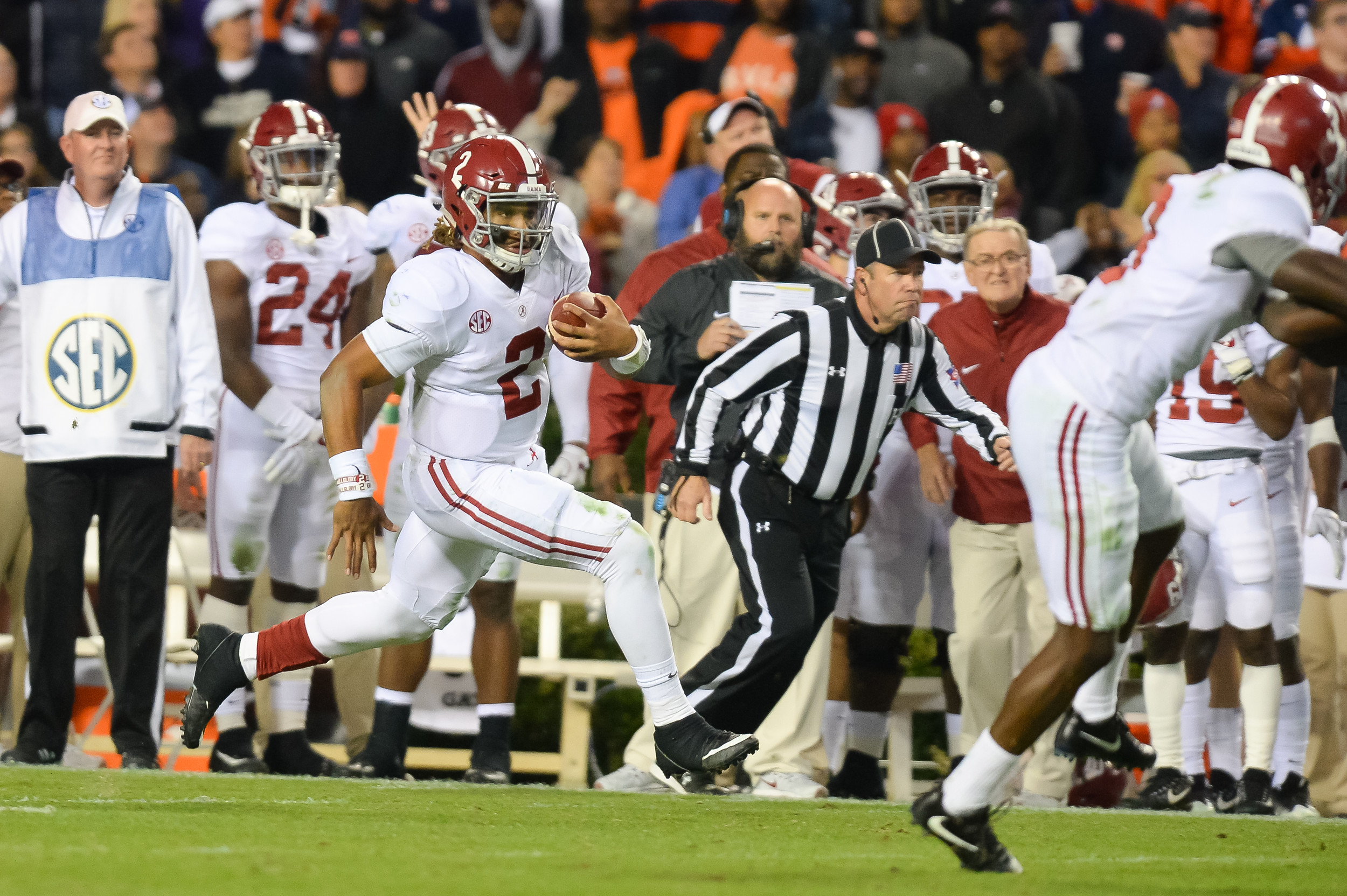 Alabama Crimson Tide quarterback Jalen Hurts (2) runs for a first down during the second half of Saturday's game, at Jordan-Hare Stadium.