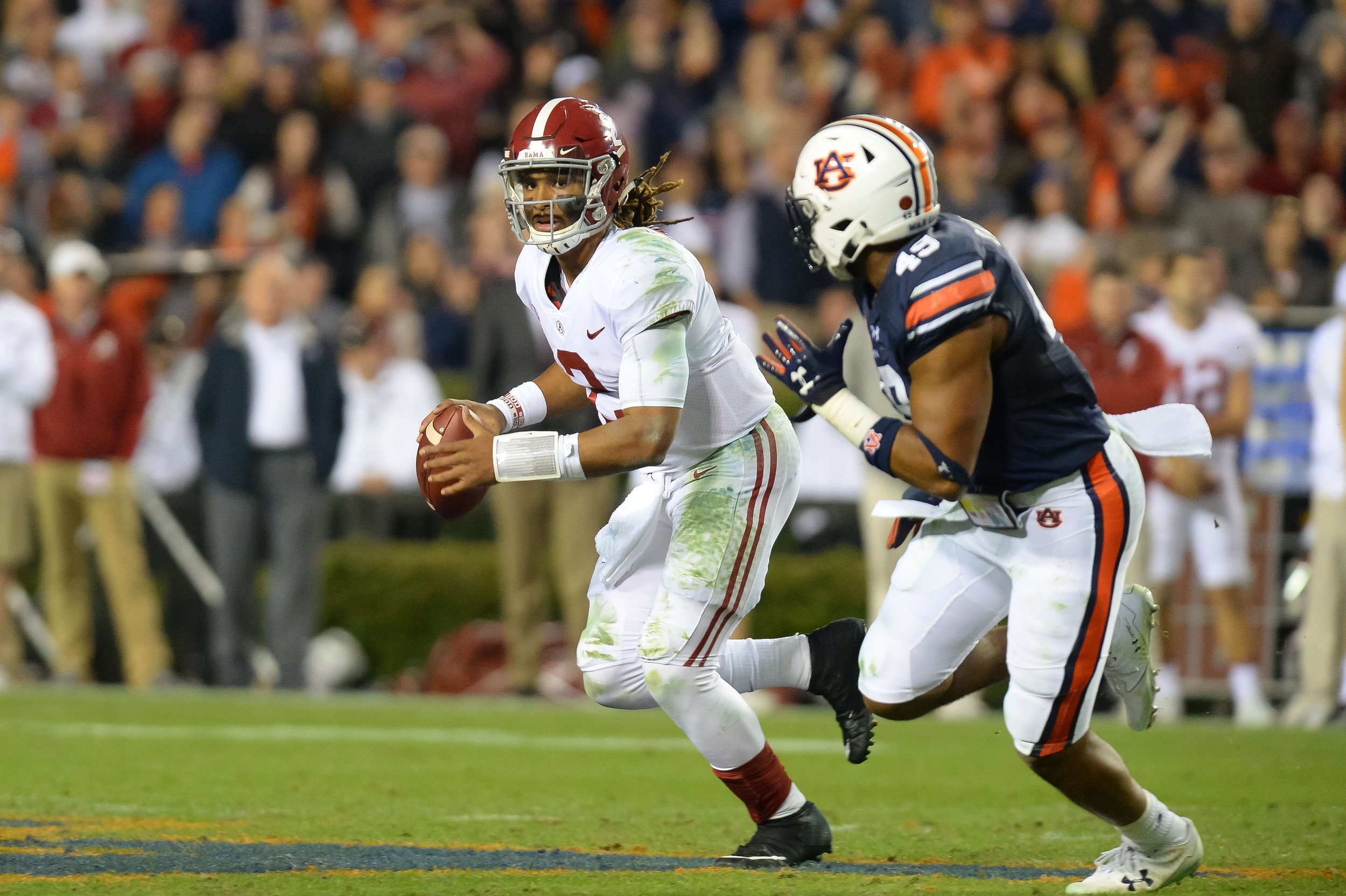 Alabama Crimson Tide quarterback Jalen Hurts (2) is pressured by Auburn Tigers linebacker Darrell Williams (49) during the second half of Saturday's game, at Jordan-Hare Stadium.