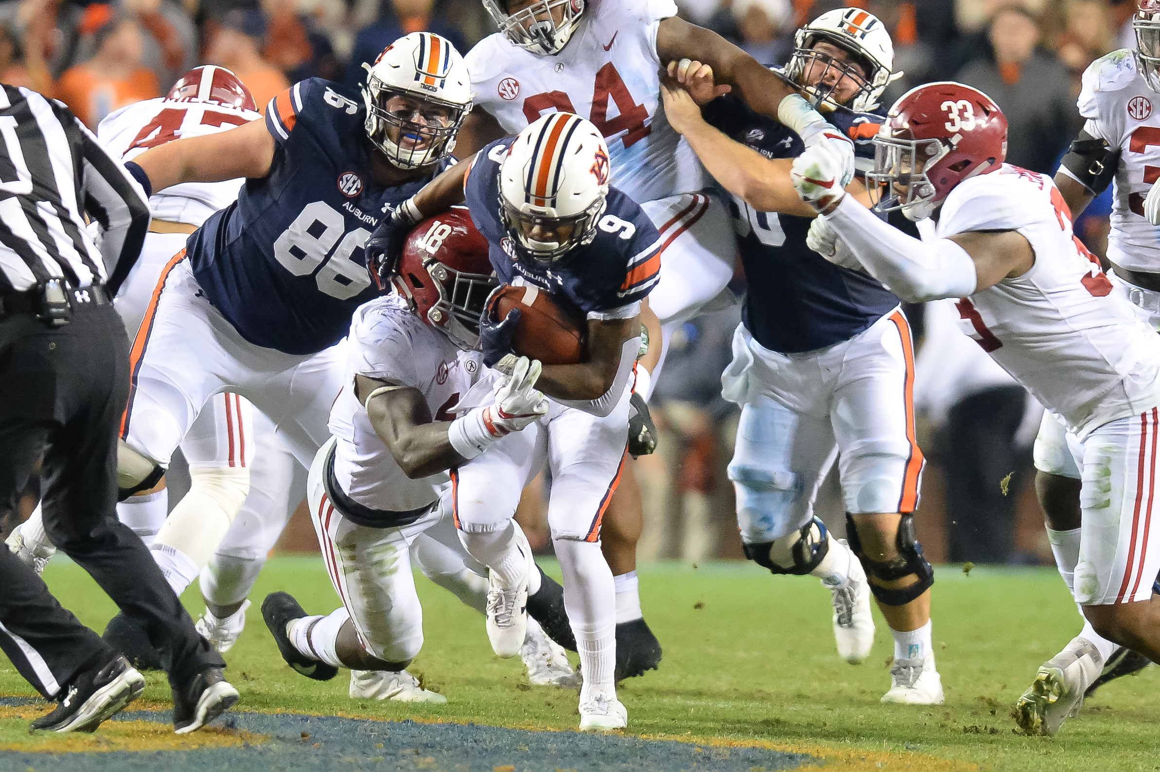 Auburn Tigers running back Kam Martin (9) is tackled by Alabama Crimson Tide linebacker Dylan Moses (18) during the second half of Saturday's game, at Jordan-Hare Stadium.