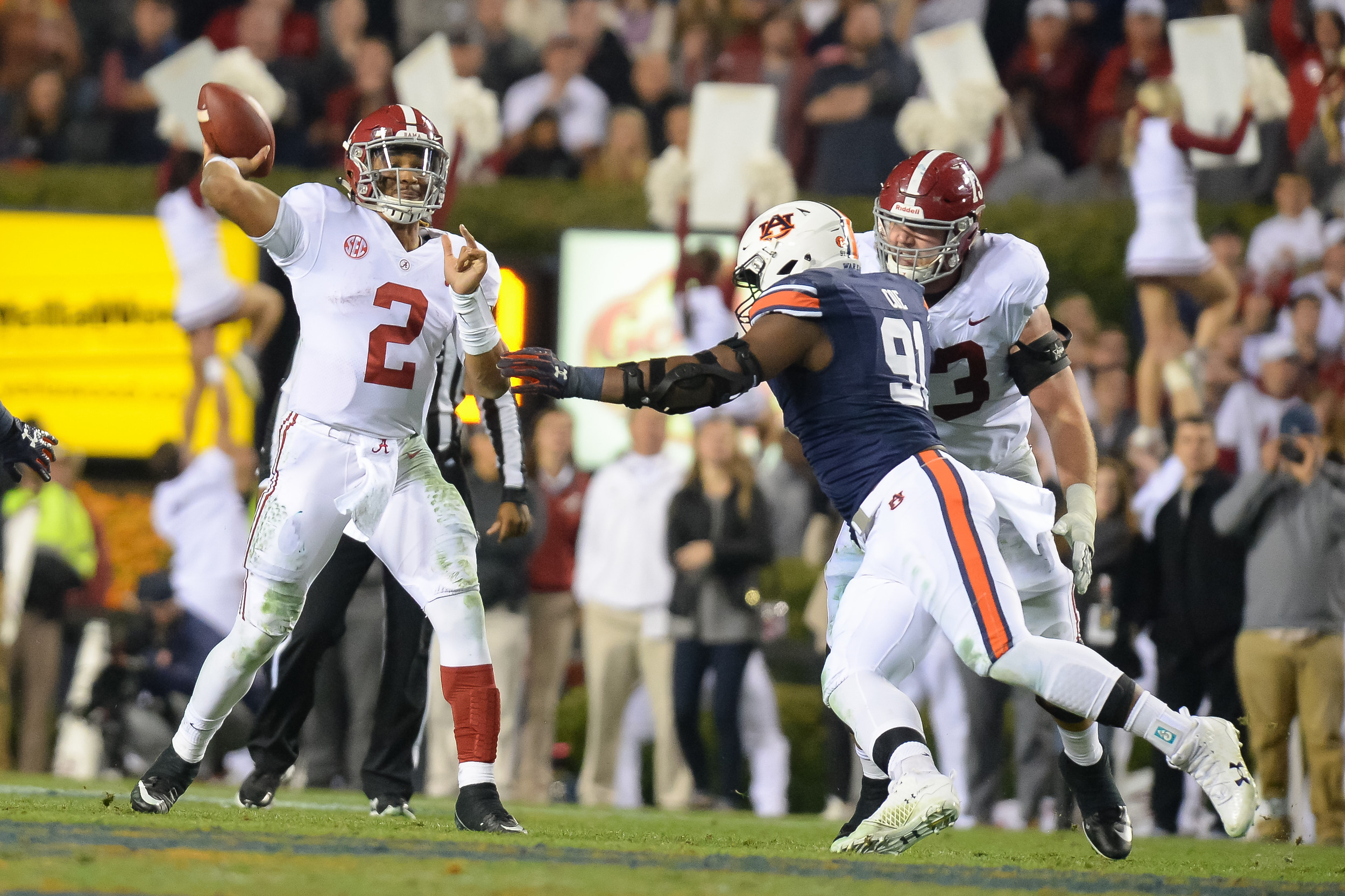 Alabama Crimson Tide quarterback Jalen Hurts (2) is pressured by Auburn Tigers defensive lineman Nick Coe (91) during the second half of Saturday's game, at Jordan-Hare Stadium.