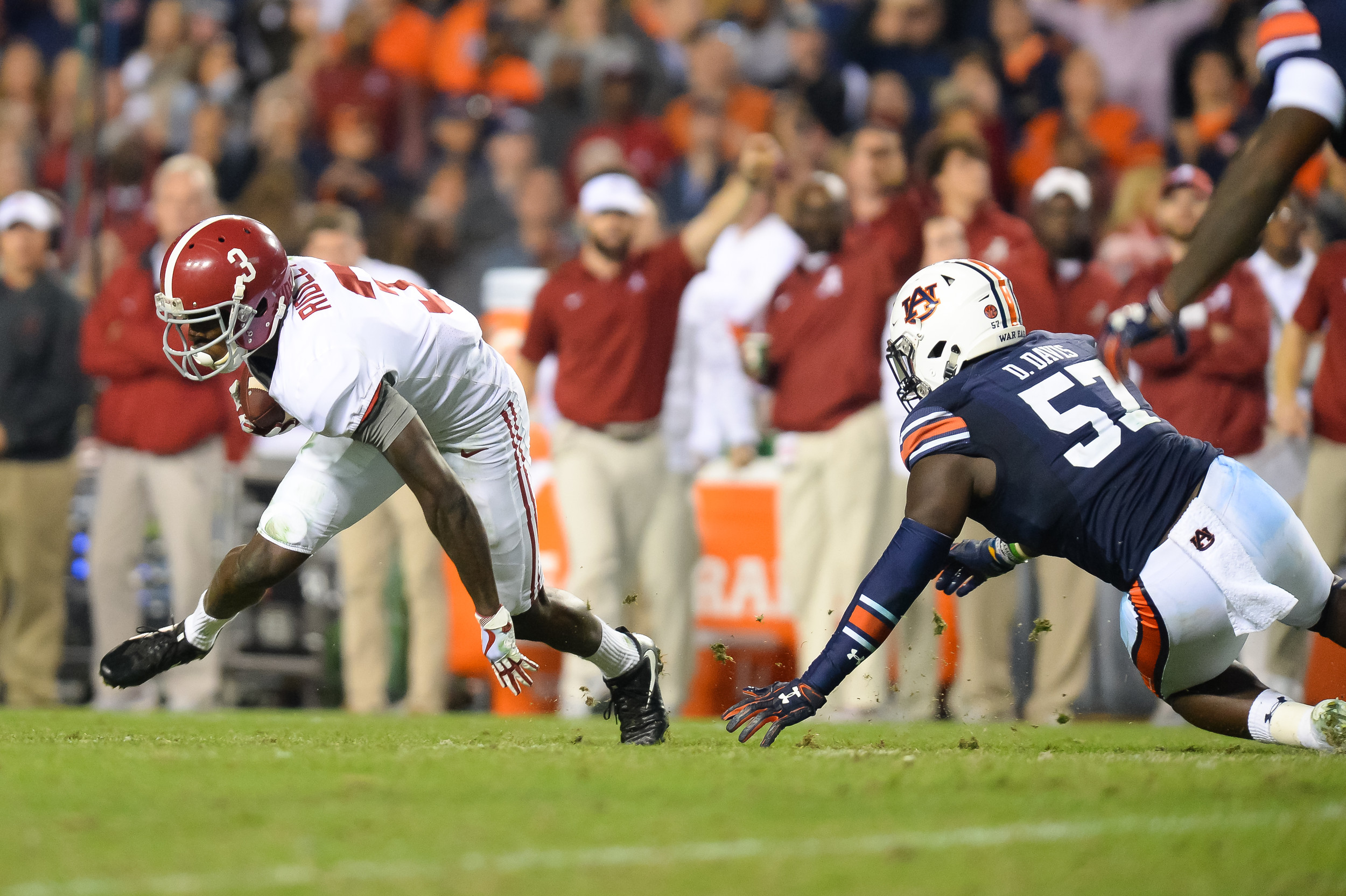 Alabama Crimson Tide wide receiver Calvin Ridley (3) runs around the tackle of Auburn Tigers linebacker Deshaun Davis (57) during the second half of Saturday's game, at Jordan-Hare Stadium.