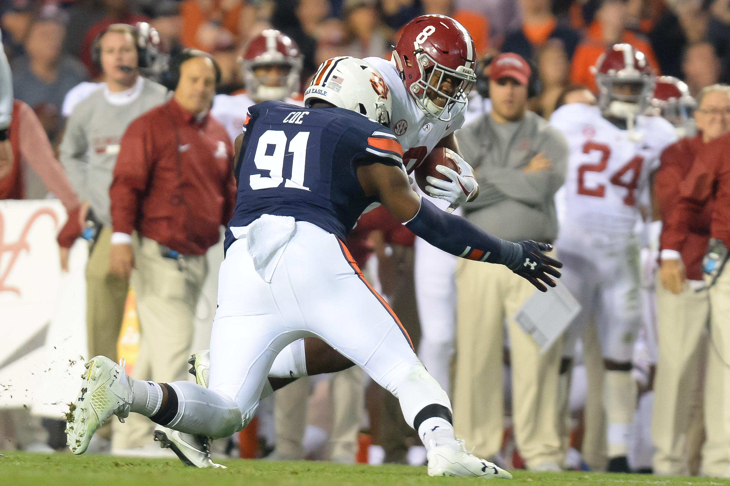 Auburn Tigers defensive lineman Nick Coe (91) tackles Alabama Crimson Tide running back Josh Jacobs (8) during the second half of Saturday's game, at Jordan-Hare Stadium.