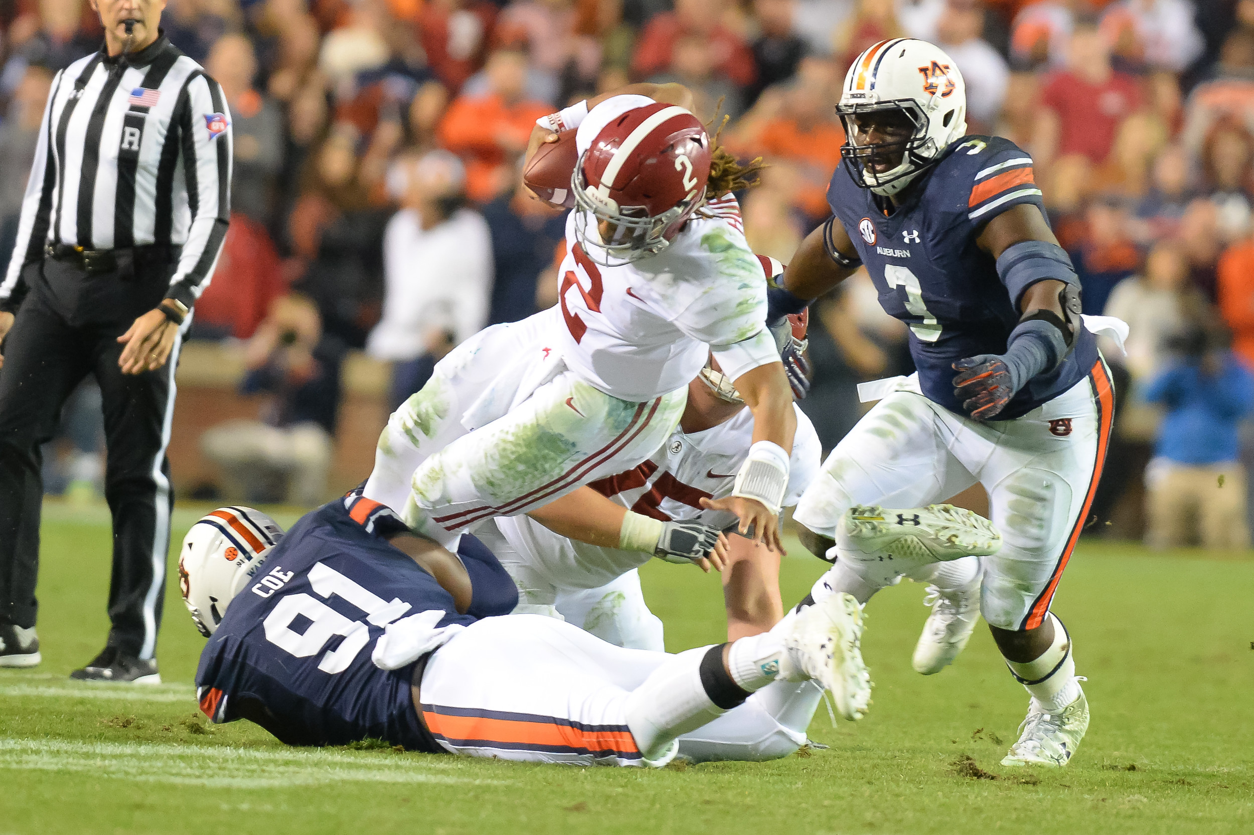 Alabama Crimson Tide quarterback Jalen Hurts (2) is sacked by Auburn Tigers defensive lineman Nick Coe (91) during the second half of Saturday's game, at Jordan-Hare Stadium.