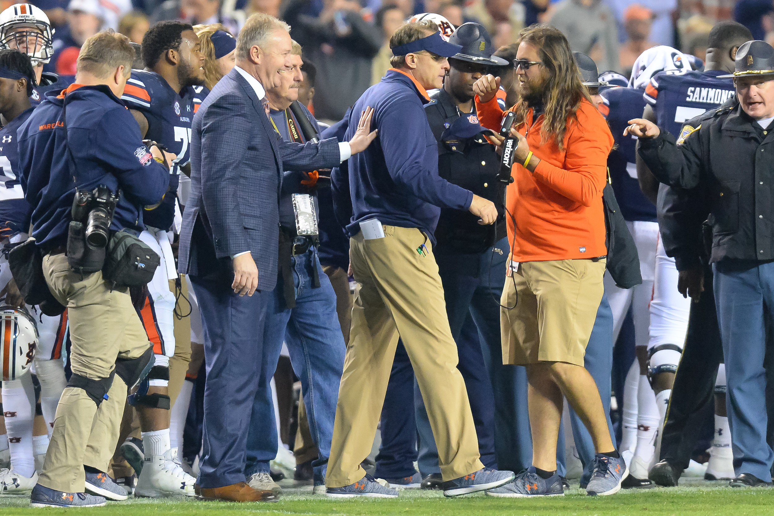 Auburn Atletic director Jay Jacobs congratulates Auburn Tigers head coach Guz Malzahn during the final seconds  of Saturday's game, at Jordan-Hare Stadium.