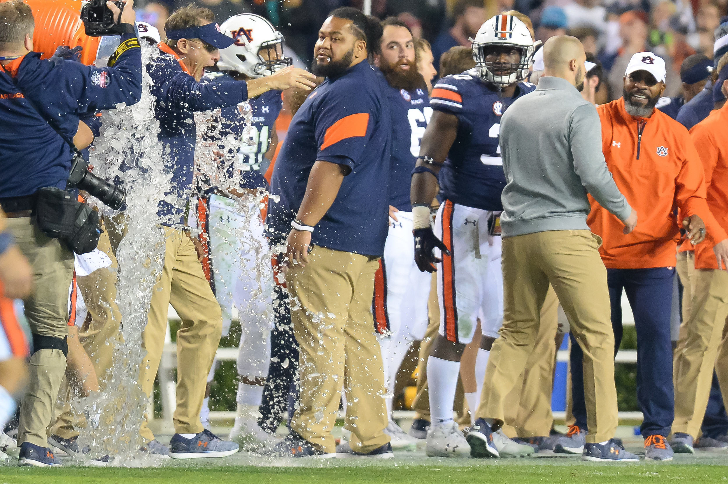 Auburn Tigers head coach Guz Malzahn is showered with ice water in the final seconds of during the second half of Saturday's 26-14 win over Alabama, at Jordan-Hare Stadium.