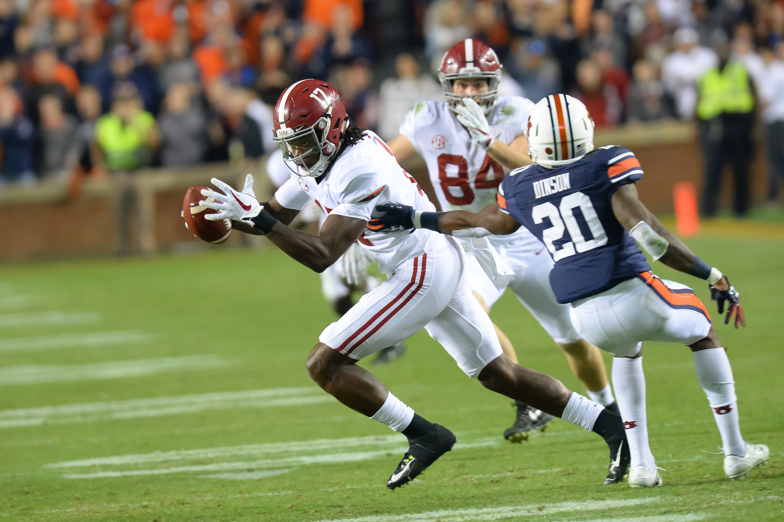 Alabama Crimson Tide wide receiver Cam Sims (17) runs past Auburn Tigers defensive back Jeremiah Dinson (20) on the final play of Saturday's game, at Jordan-Hare Stadium.