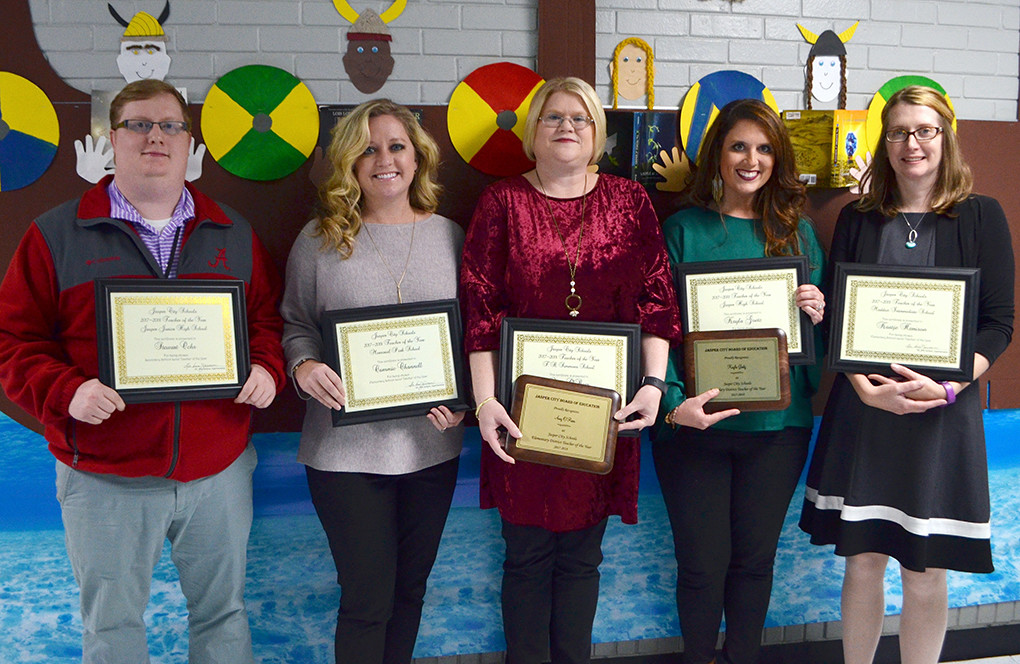 From left, Stewart Ochs (Jasper Jr. High), Cameron Channell (Memorial Park Elementary), Amy O'Rear (T.R. Simmons Elementary), Kayla Goetz (Jasper High) and Kaatje Harrison (Maddox Intermediate) were all named Teachers of the Year by the Jasper City Board of Education Monday night.