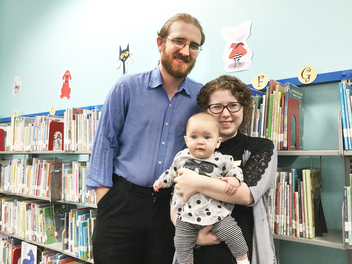 Alaina, daughter Athena, and husband Dalton Browning at the Anniston Library.