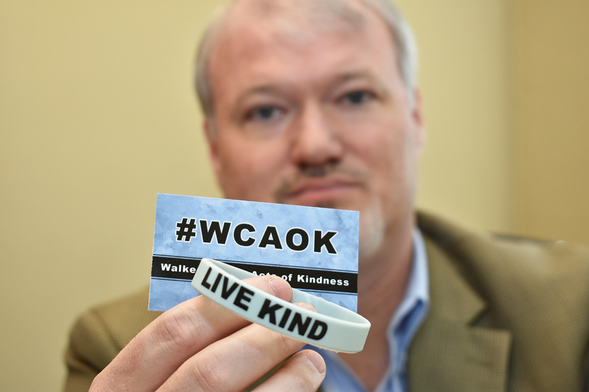 District 1 Walker County Commissioner Keith Davis displays the card and bracelet that will be used in his new Walker County Acts of Kindness program that he will promote in the county.