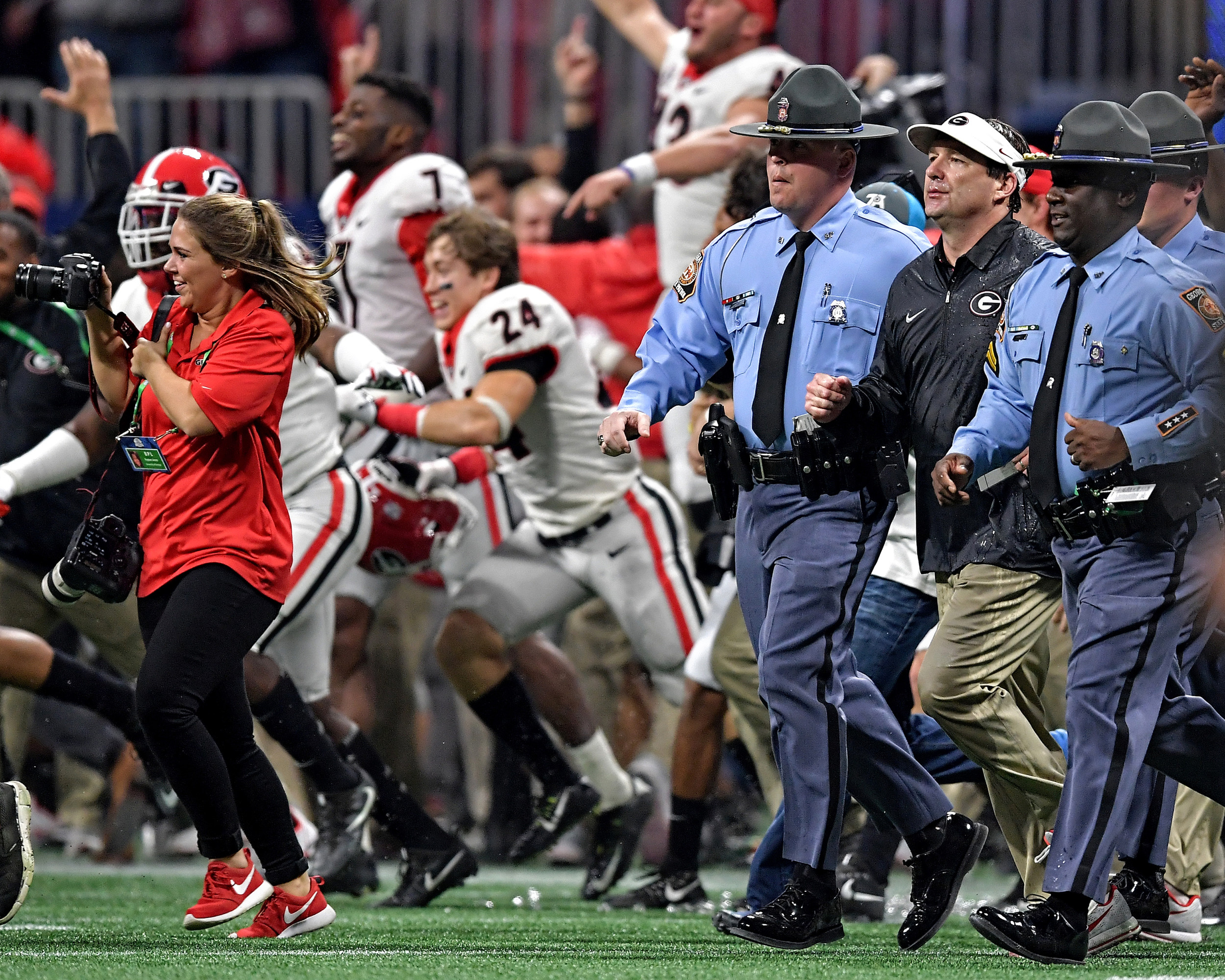 From the post-game celebration and trophy presentation following Georgia's win over Auburn in the 2017 SEC Championship Game between the Georgia Bulldogs and the Auburn Tigers on Dec. 2, 2017, at the Mercedes-Benz Stadium in Atlanta, Ga. Georgia won 28-7. (Photo by Lee Walls)