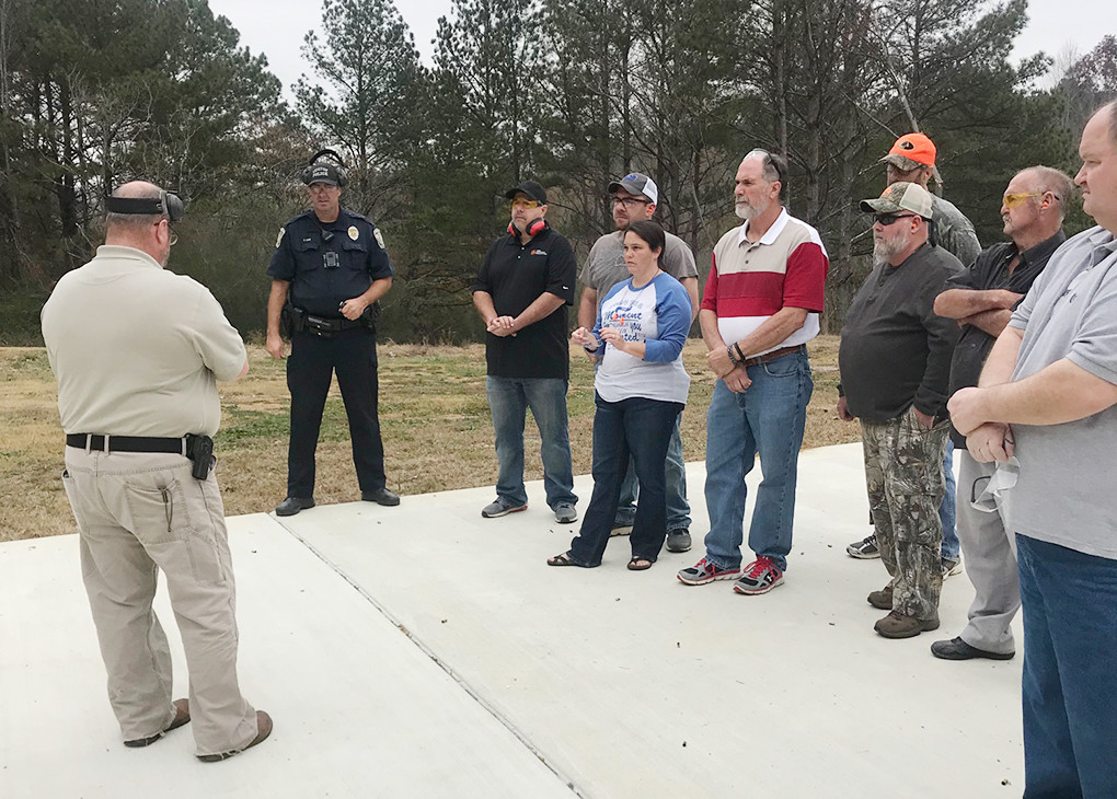 Sumiton Police Chief T.J. Burnett, at left, led a church group through firearms training this past Saturday.