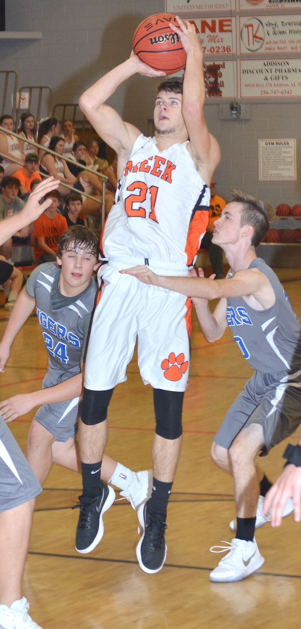 Meek's Luke Sherer (21) shoots a jumper during the Tigers' home game against Brilliant on Monday night. Sherer had 11 points in Meek's 62-36 win. The Tigers are now 4-0 on the season.