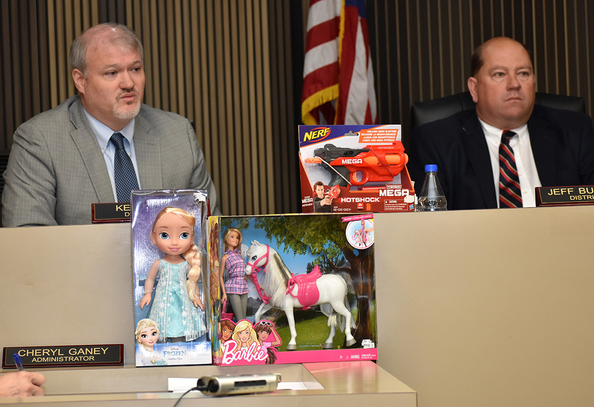 District 1 Walker County Commission Keith Davis, left) speaks at Monday's commission meeting, while District 2 Commissioner Jeff Burroughs sits nearby. Toys were displayed at the meeting to encourage donations to the Holiday Toy Drive, whose giveaway has now been delayed until Dec. 16.