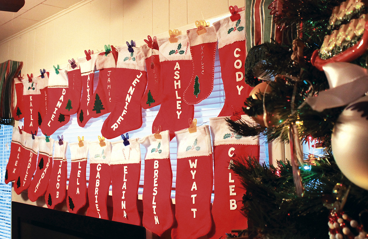 Christmas stockings bearing the names of Helen Clement's granchildren hang in the front window of her Jasper residence. Clement made five stockings for her children when they were young. The tradition has grown to include 60 stockings for her children, grandchildren, great-grandchildren and spouses.