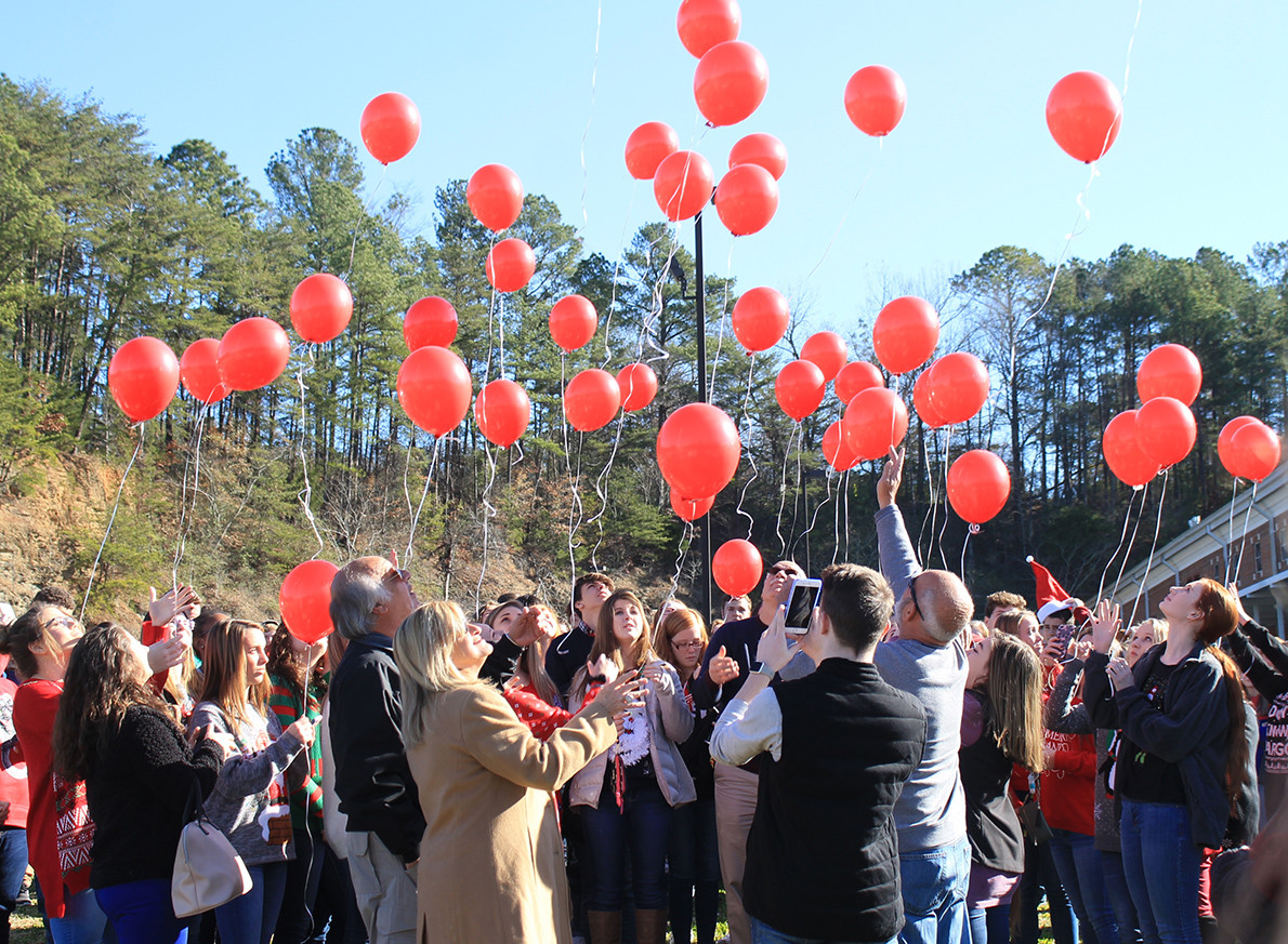 Cordova High School students and family members of Brittany Owens release balloons in her memory Monday morning. Friday was the first anniversary of Owens' death.