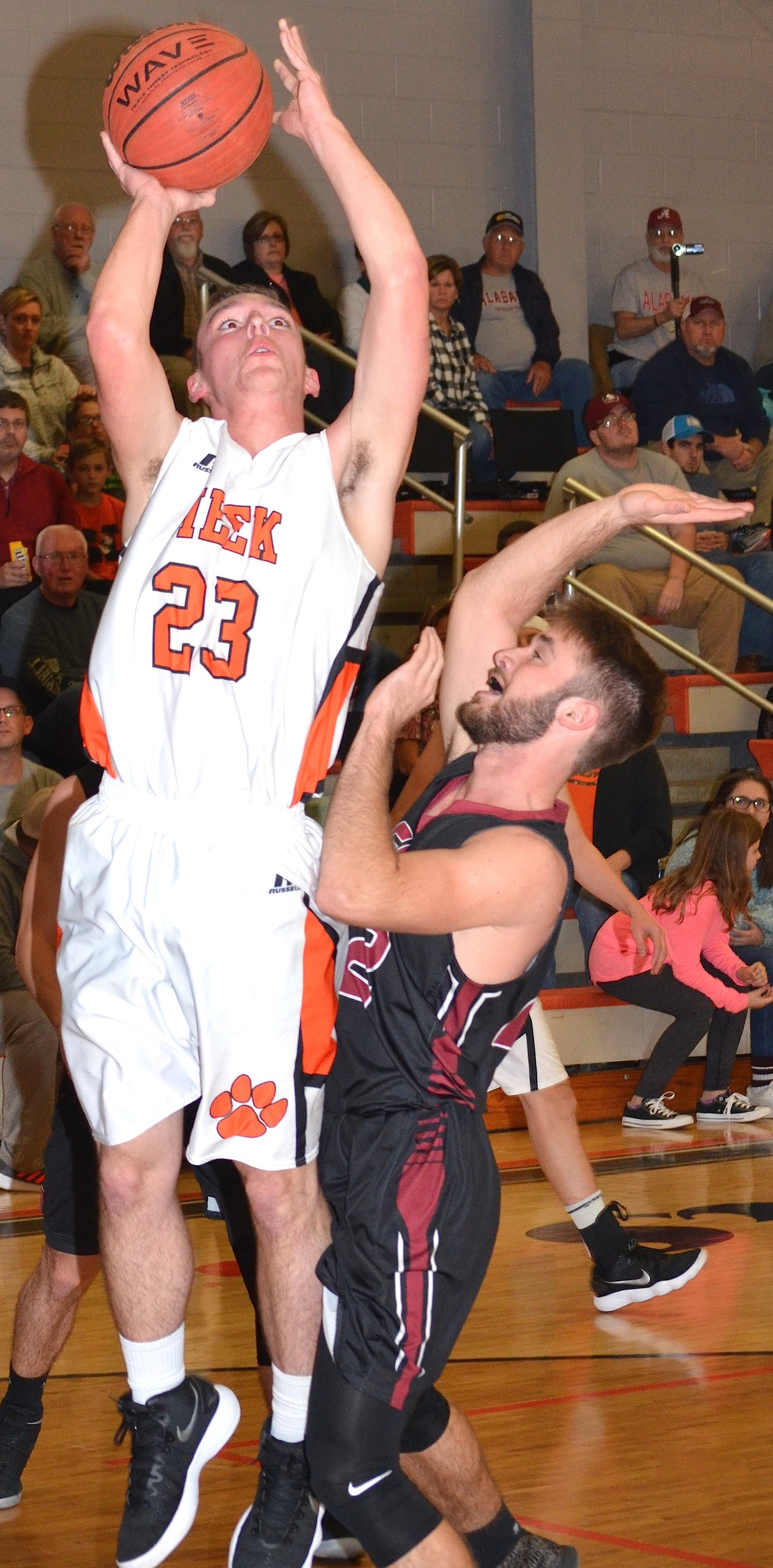 Meek's Ian Sargent (23) goes up for a shot in front of Sumiton Christian's Jeremy Brown during their game at Meek High School on Monday night. The Tigers moved to 7-0 on the season with a 45-44 victory.