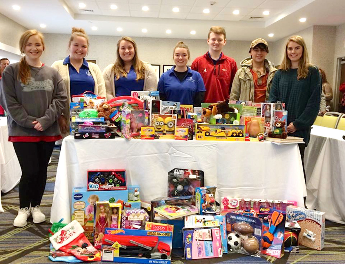 Scholars with the Walker College Foundation recently collected toys for Capstone Rural Health to distribute to children in need in Walker County.