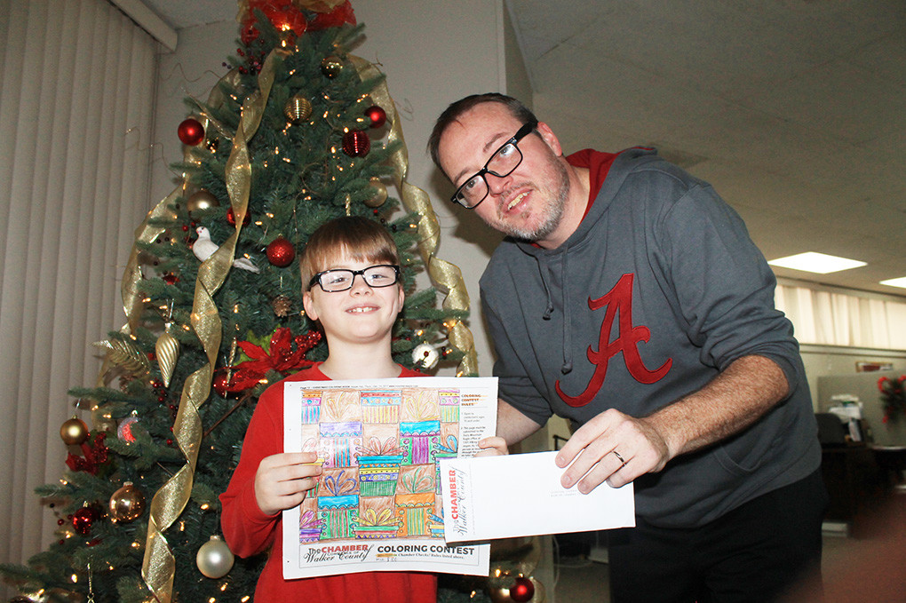 The winner of the Daily Mountain Eagle Christmas Coloring Book Contest was Luke Roberts, an 8-year-old from Jasper. Roberts was chosen from hundreds of entries and was presented $100 in Chamber Checks by DME Publisher James Phillips.