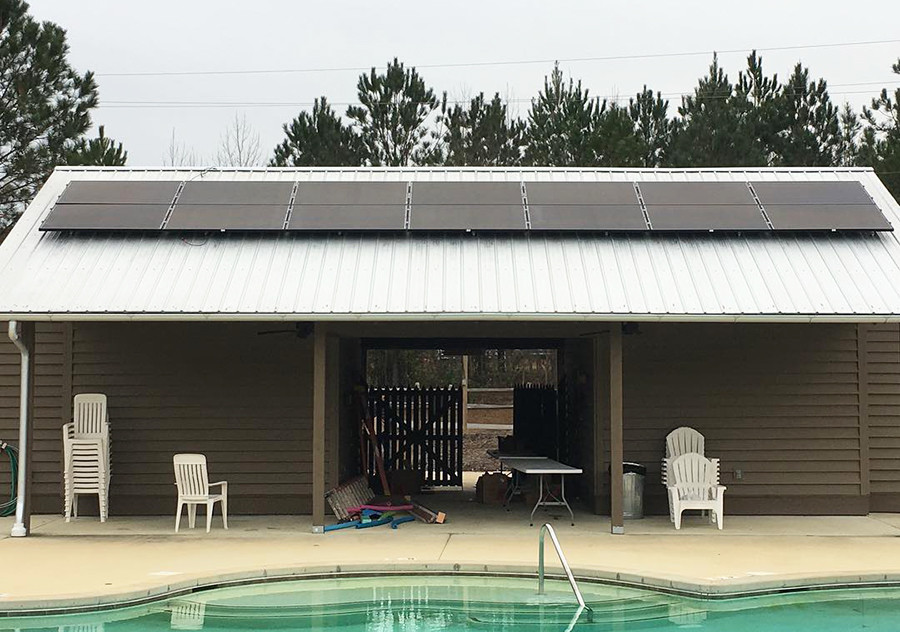 Solar panels have been installed near St. John's Pool in Camp McDowell's Bethany Village. The solar project will eventually generate power for five buildings at the camp.