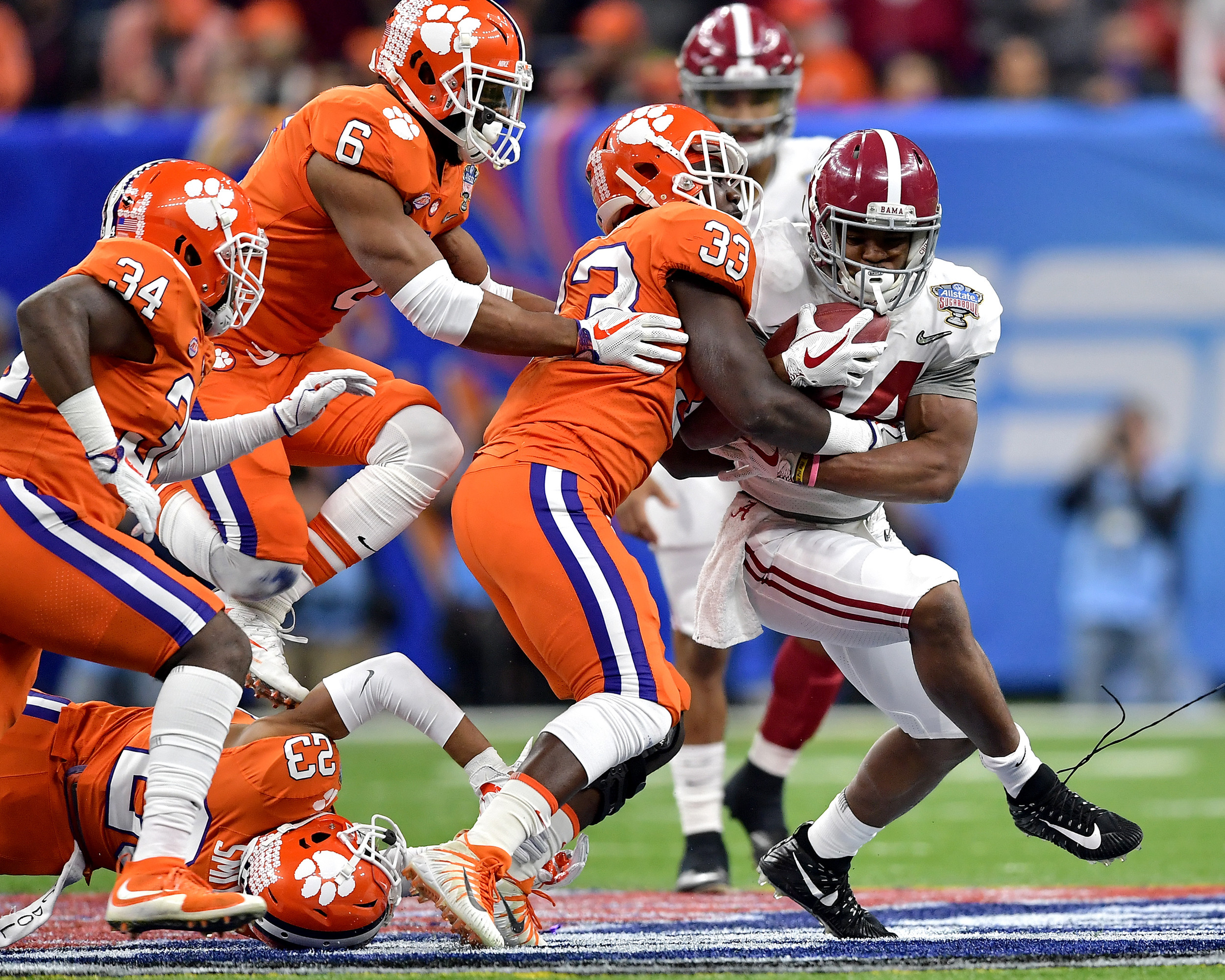 Alabama Crimson Tide running back Damien Harris (34) with a carry in the first half of the 2018 AllState Sugar Bowl on Jan. 1, 2018, at the Mercedes-Benz SuperDome in New Orleans, La. Alabama won the game 24-6. (Photo by Lee Walls)