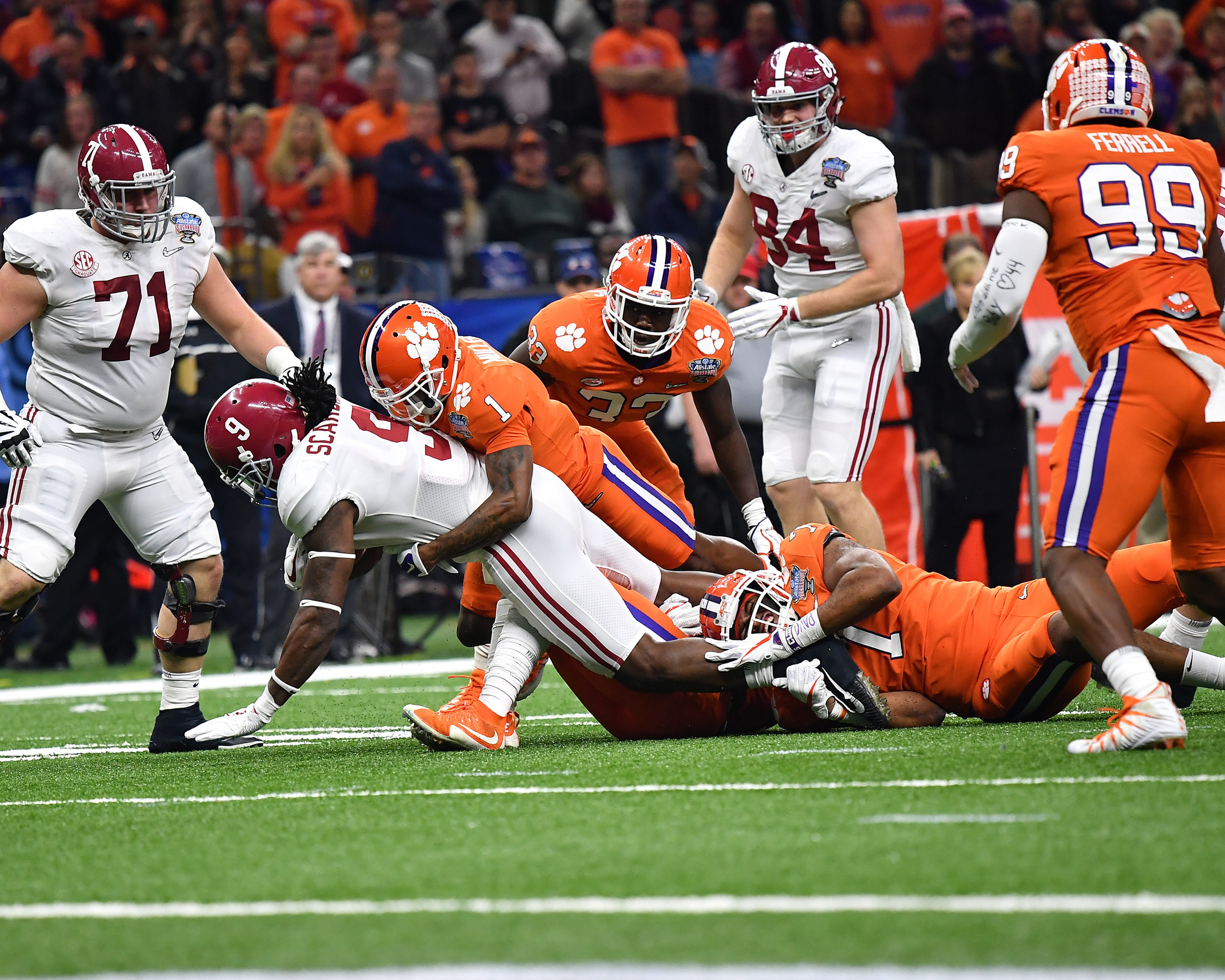 Alabama Crimson Tide running back Bo Scarbrough (9) is tackled in the first half of the 2018 AllState Sugar Bowl on Jan. 1, 2018, at the Mercedes-Benz SuperDome in New Orleans, La. Alabama won the game 24-6. (Photo by Lee Walls)