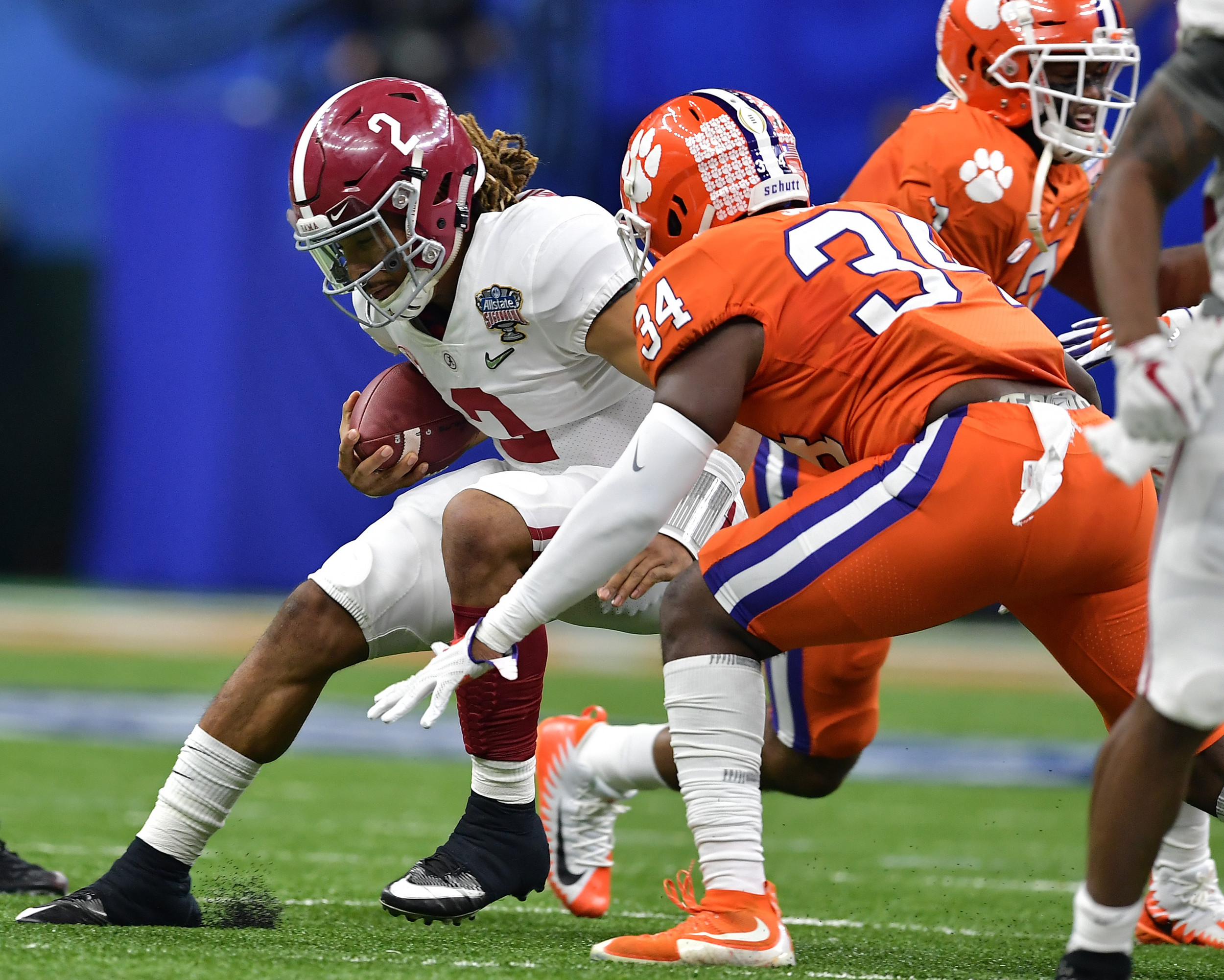 Alabama Crimson Tide quarterback Jalen Hurts (2) tries to avoid a tackle in the first half of the 2018 AllState Sugar Bowl on Jan. 1, 2018, at the Mercedes-Benz SuperDome in New Orleans, La. Alabama won the game 24-6. (Photo by Lee Walls)