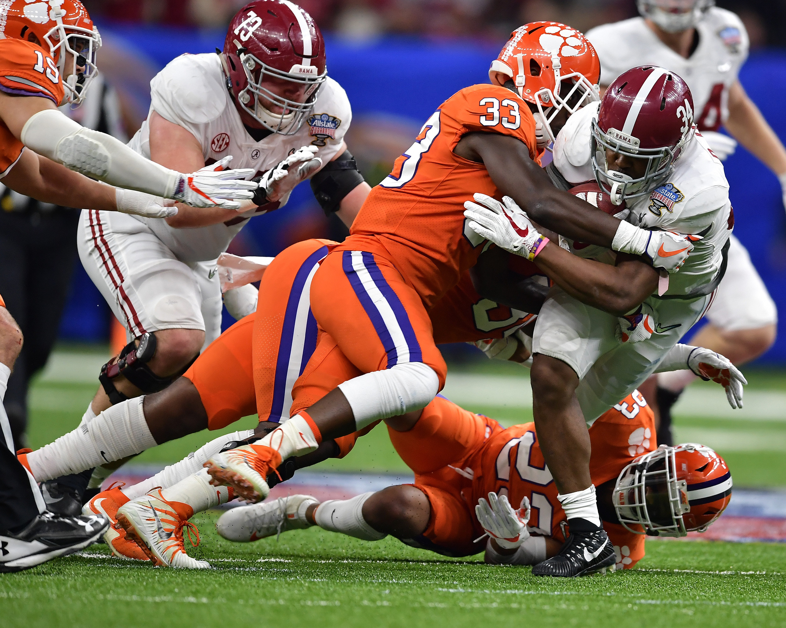 Alabama Crimson Tide running back Damien Harris (34) is tackled during the first half of the 2018 AllState Sugar Bowl on Jan. 1, 2018, at the Mercedes-Benz SuperDome in New Orleans, La. Alabama won the game 24-6. (Photo by Lee Walls)
