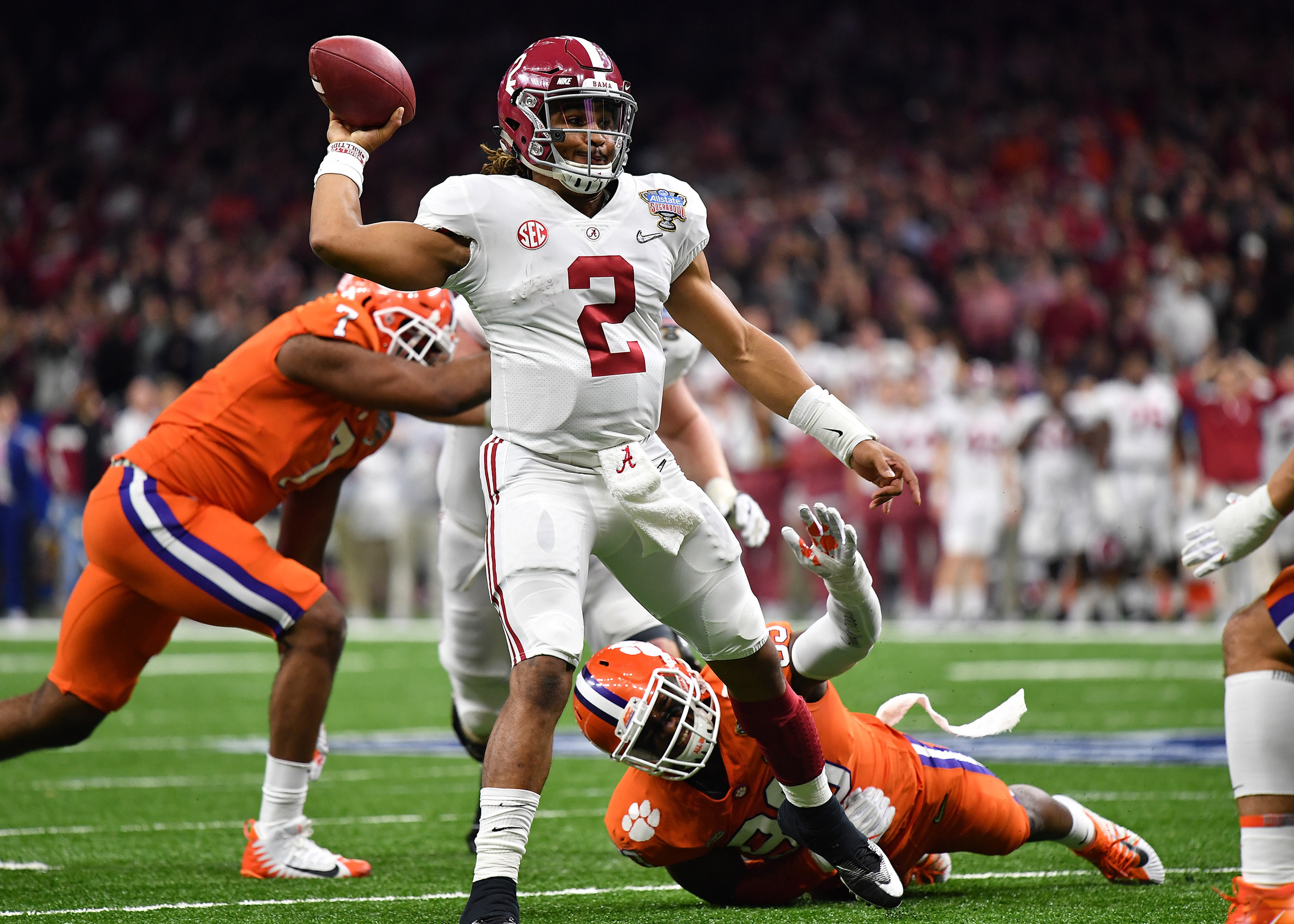 Alabama Crimson Tide quarterback Jalen Hurts avoids a tackle prior to throwing a touchdown pass in the first half of the 2018 AllState Sugar Bowl on Jan. 1, 2018, at the Mercedes-Benz SuperDome in New Orleans, La. Alabama won the game 24-6. (Photo by Lee Walls)