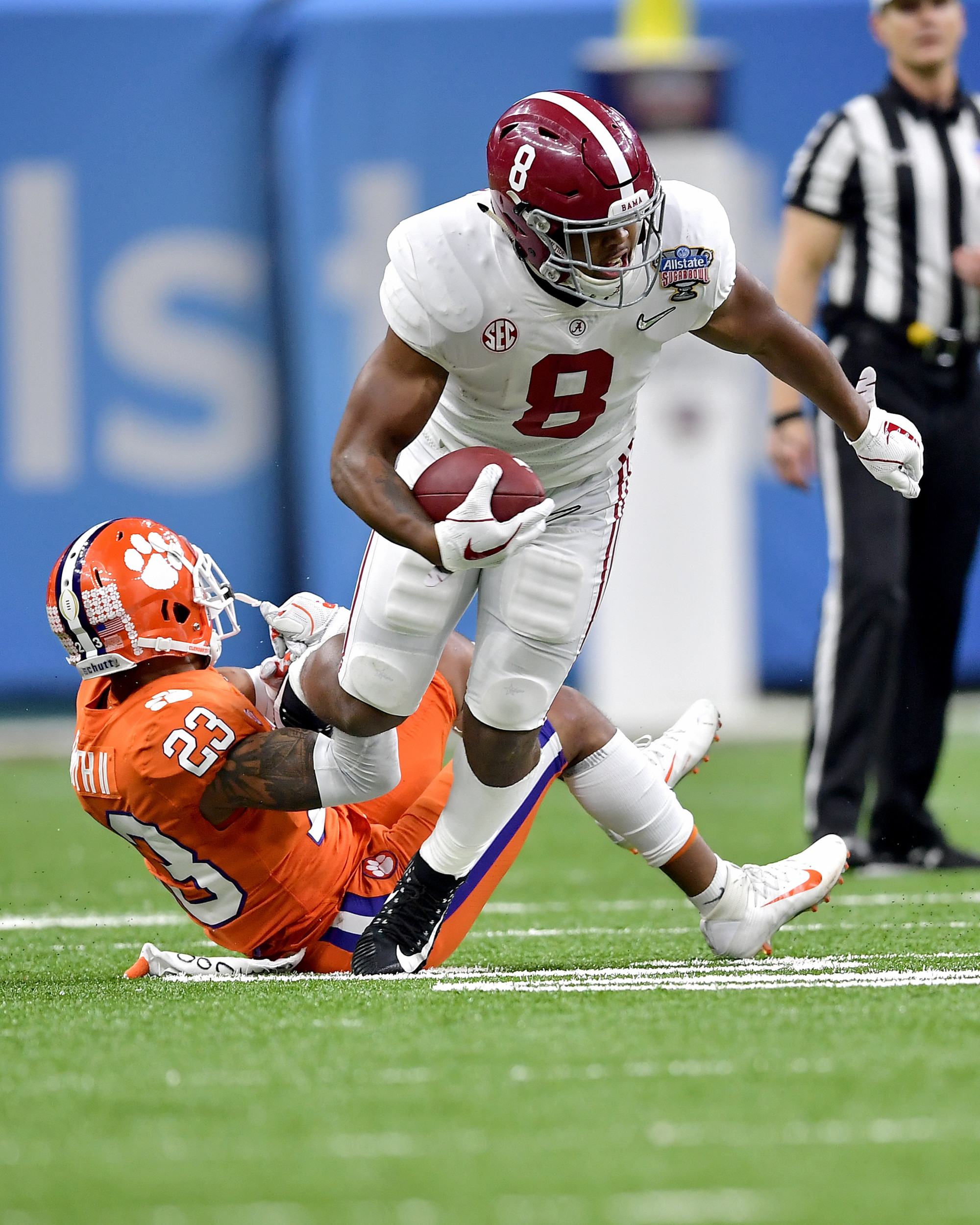 Alabama Crimson Tide running back Josh Jacobs (8) tries to get loose from Clemson Tigers safety Van Smith (23) in the first half of the 2018 AllState Sugar Bowl on Jan. 1, 2018, at the Mercedes-Benz SuperDome in New Orleans, La. Alabama won the game 24-6. (Photo by Lee Walls)