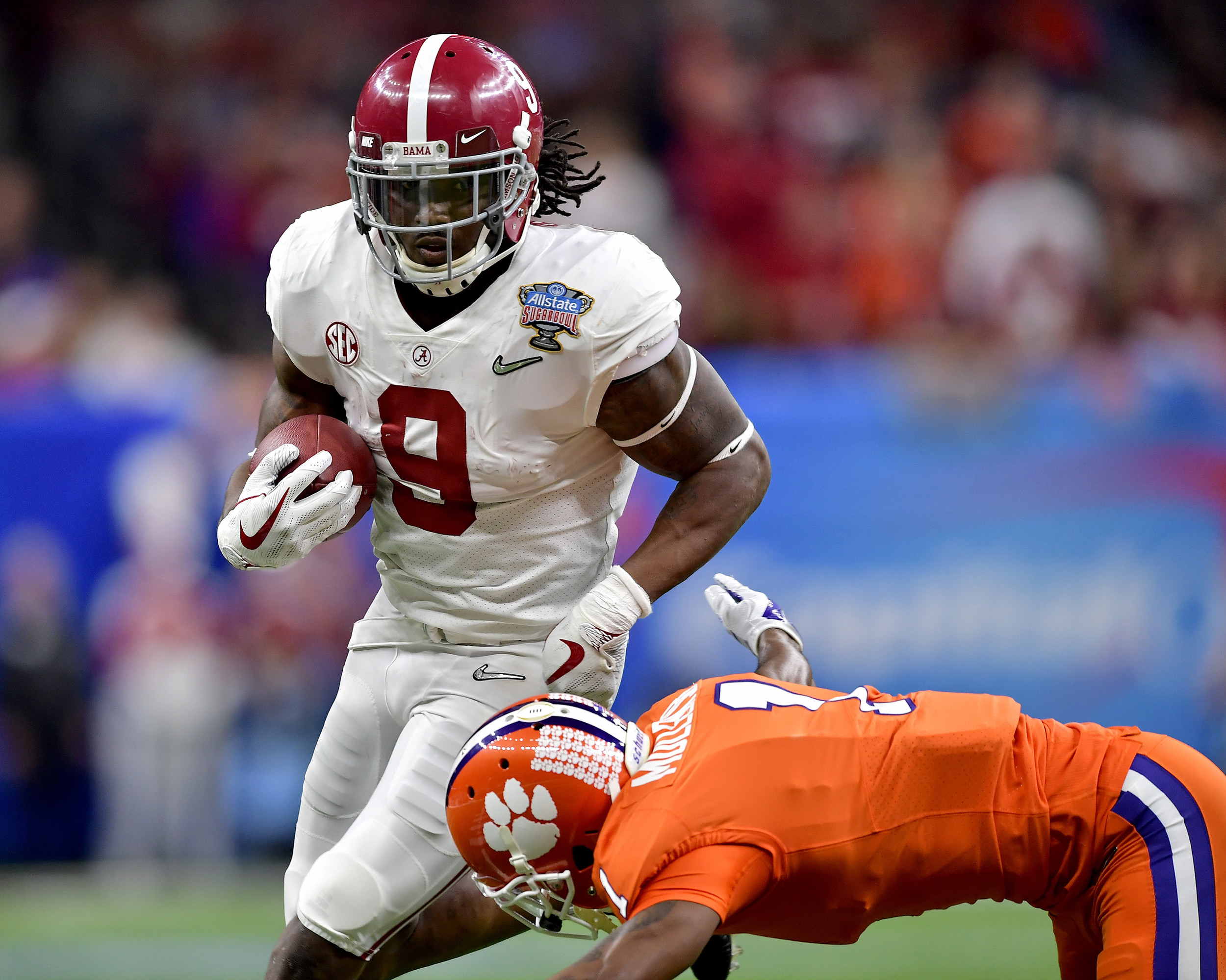 Alabama Crimson Tide running back Bo Scarbrough (9) with a carry in the second quarter of the 2018 AllState Sugar Bowl on Jan. 1, 2018, at the Mercedes-Benz SuperDome in New Orleans, La. Alabama won the game 24-6. (Photo by Lee Walls)
