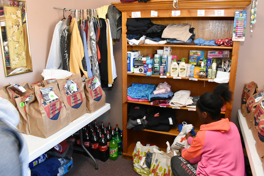 Markeetia Williams of Jasper volunteers Tuesday to help with donated supplies at the winter warming station set up at Maranatha Baptist Church.