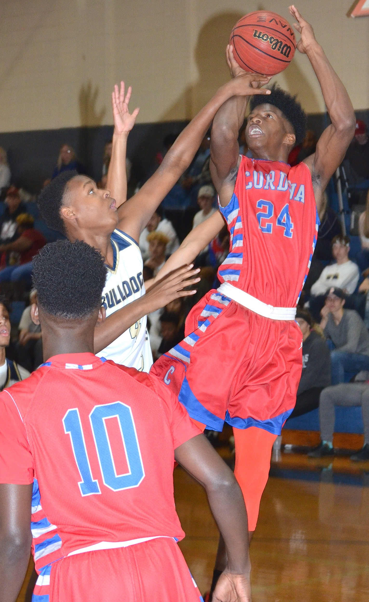 Cordova's Isaac Chatman (24) shoots a jumper against Dora during their game on Tuesday night. Chatman had 27 points and 16 rebounds in the Blue Devils' 68-49 win.