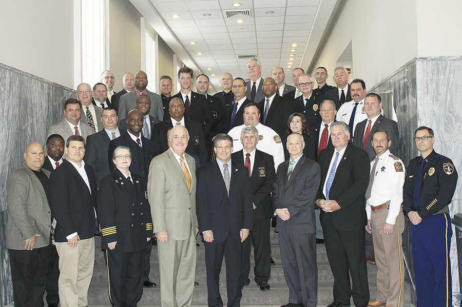 Alabama Department of Economic and Community Affairs Director Kenneth Boswell, fourth from left, and Alabama Law Enforcement Agency Secretary Hal Taylor, fifth from left, pose with representatives of the more than 40 agencies that make up the new Alabama Drug Enforcement Task Force. Walker County has three members on the task force.