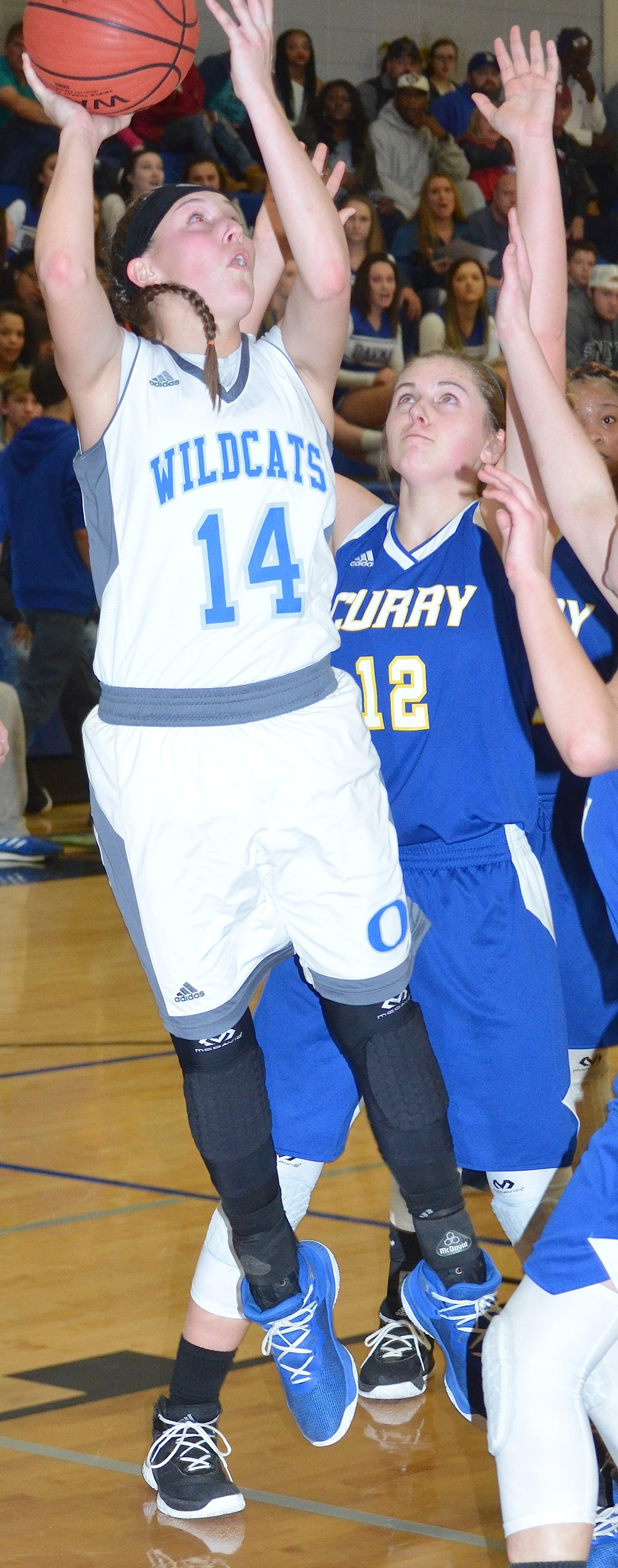 Oakman's Heather Thompson (14) shoots as Curry's Morgan Davison (12) defends during their Walker County Basketball Tournament game Friday at Carbon Hill High School. Thompson had a triple double in the Wildcats' 46-35 win.