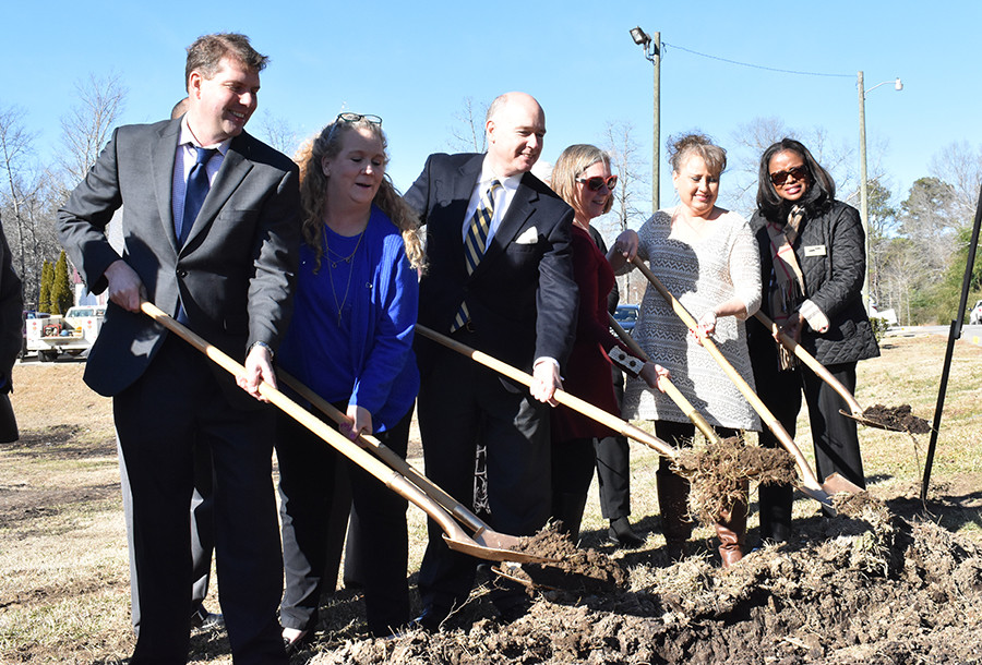 Shoveling dirt during the groundbreaking Wednesday for the new Captstone Rural Health Clinic in Parrish are, from left, Capstone Executive Director F. David Jones, Parrish Mayor Heather Hall, U.S. Rep. Robert Aderholt, Pam Callahan of Jasper of Honda, Capstone Health Board Chairwoman Marcy Brown and Lisa Likely of the U.S. Department of Agriculture.