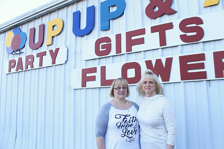 Barbara Williams, left, a longtime employee of Up,Up & Away, and store owner Pat Johnson stand outside Walker County's go-to place for party supplies, costumes and gifts. The store is expected to close in early March.