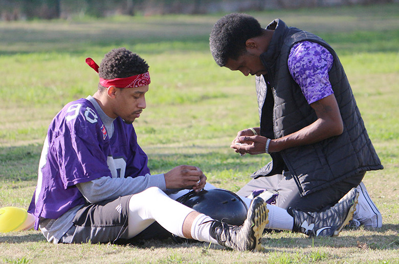 P-Town Wreckaz owner Nicholas Hammond, right, works with a player during a mini camp held in November.