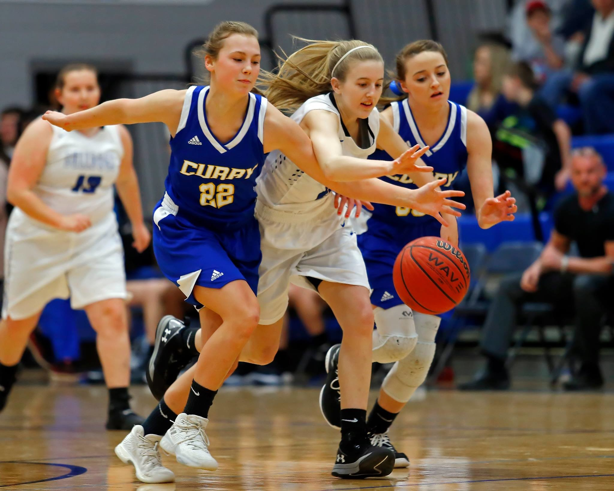 Carbon Hill's Abby Martin, center, battles Curry's Rae Ann Hall (22) and Kayla Sargent (33) for a loose ball on Friday night. Carbon Hill won the game 50-35.