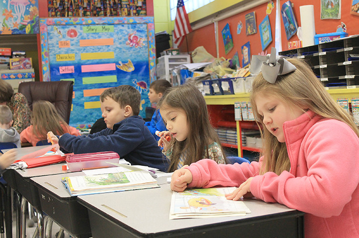 Students in Dusti Windham's first grade class work quietly on an assignment Monday morning.