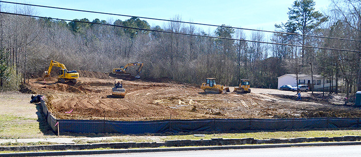 On Jan. 31, workers were preparing land across from Oakman High School for a new town development. The name of the business to locate here will be announced in the coming weeks.