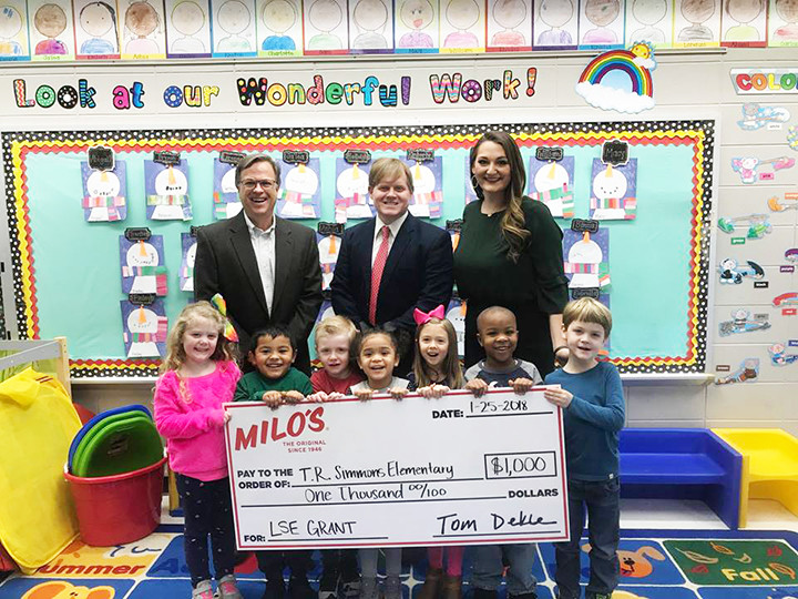 Milo's Hamburgers awarded a $1,000 grant to T.R. Simmons Elementary School to provide technology upgrades in their classrooms.