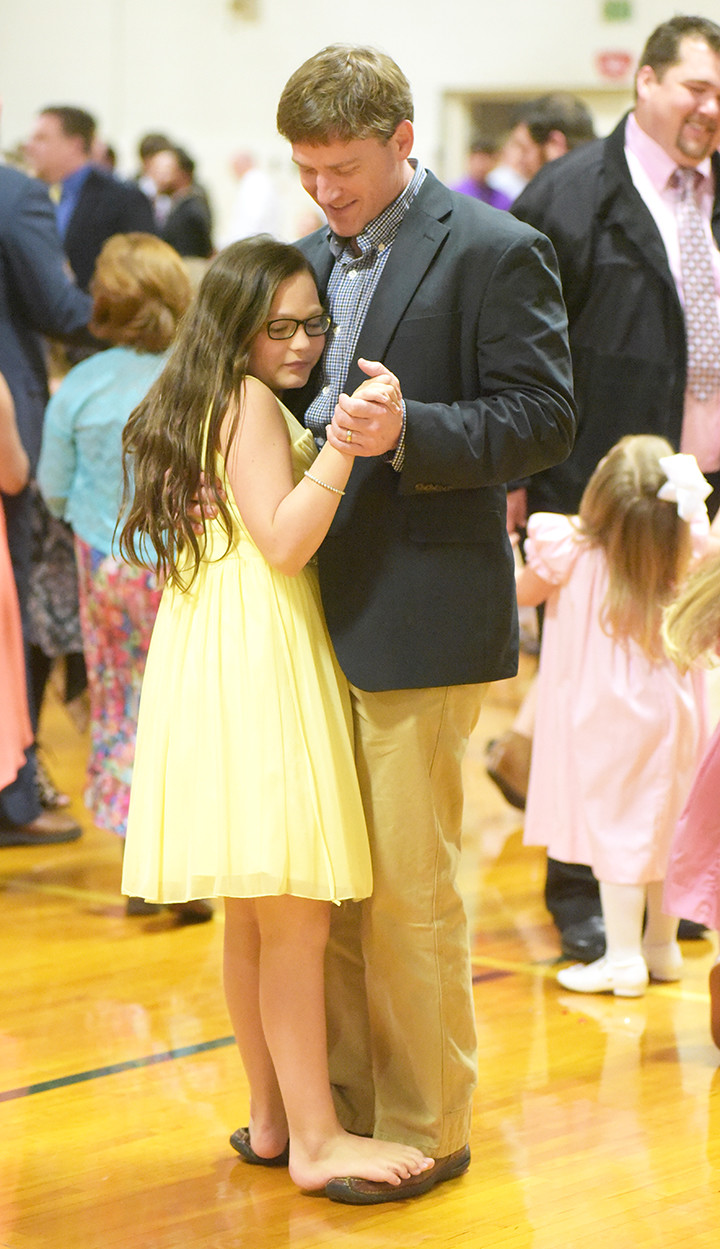 Douglas Saunders and his daughter Ellie enjoy a dance during last year's Daddy and Me Dance held at 