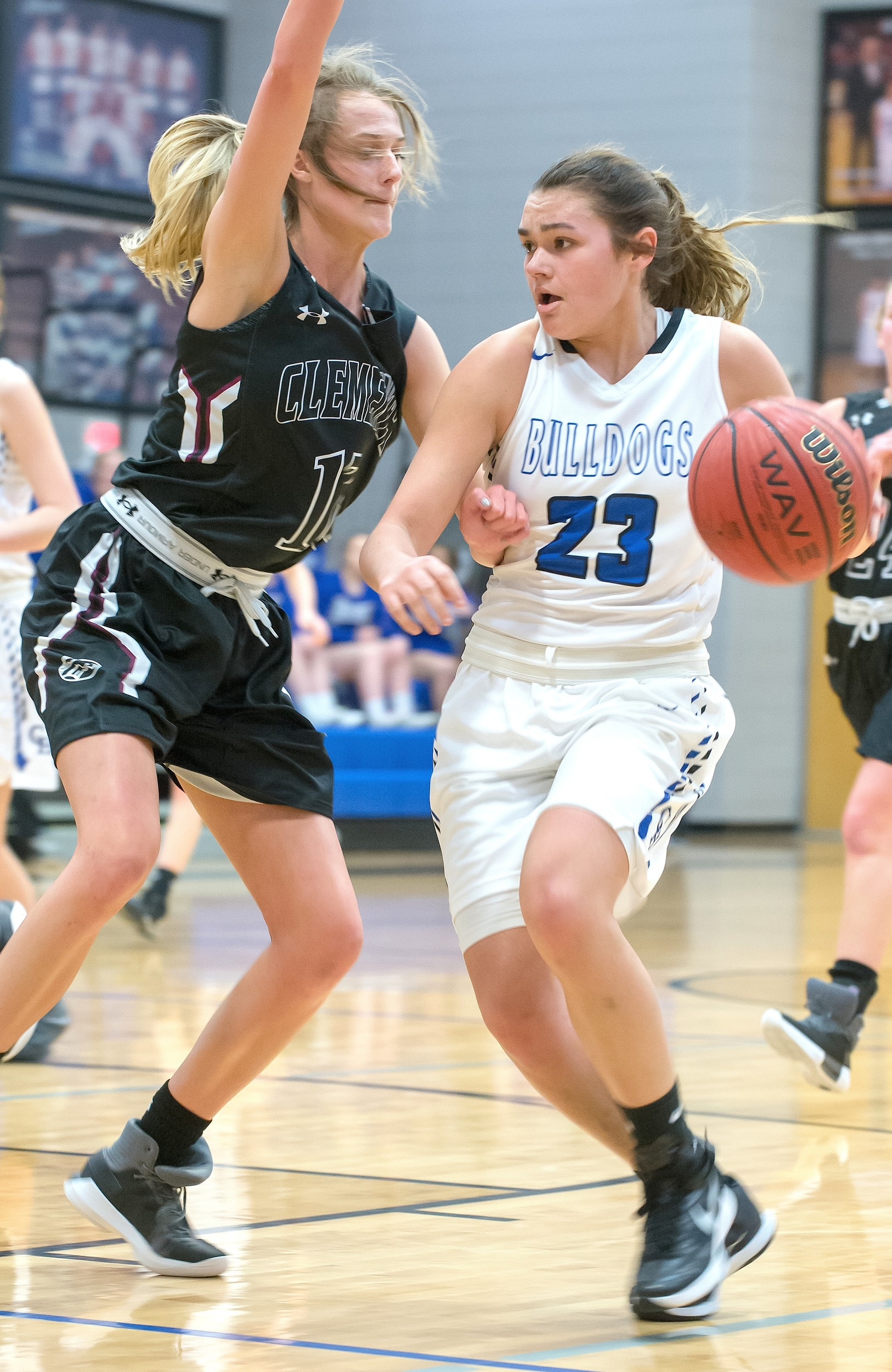 Carbon Hill's Molly Kate Atkins (23) is defended by Clements'  Anna Page (12) during their 3A sub-region game at Carbon Hill High School on Monday. Atkins had 24 points in the Bulldogs' 65-58 win.