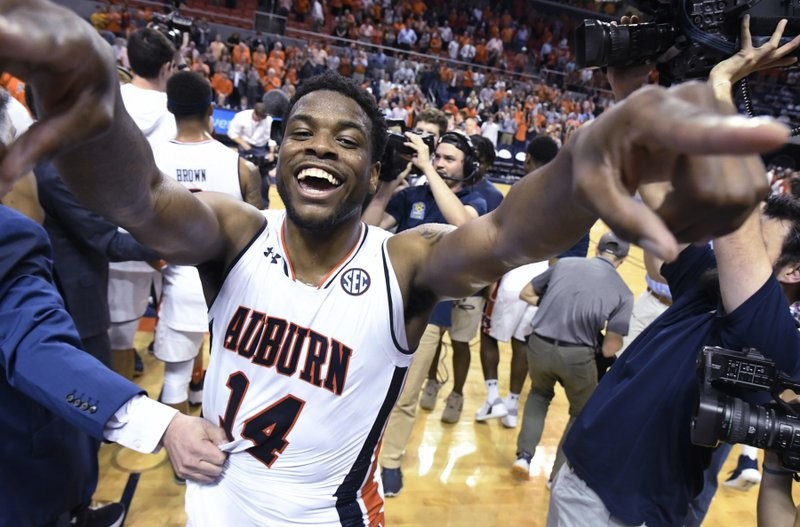 Auburn guard Malik Dunbar celebrates on the court after Auburn defeated Alabama 90-71 on Wednesday in Auburn Arena
